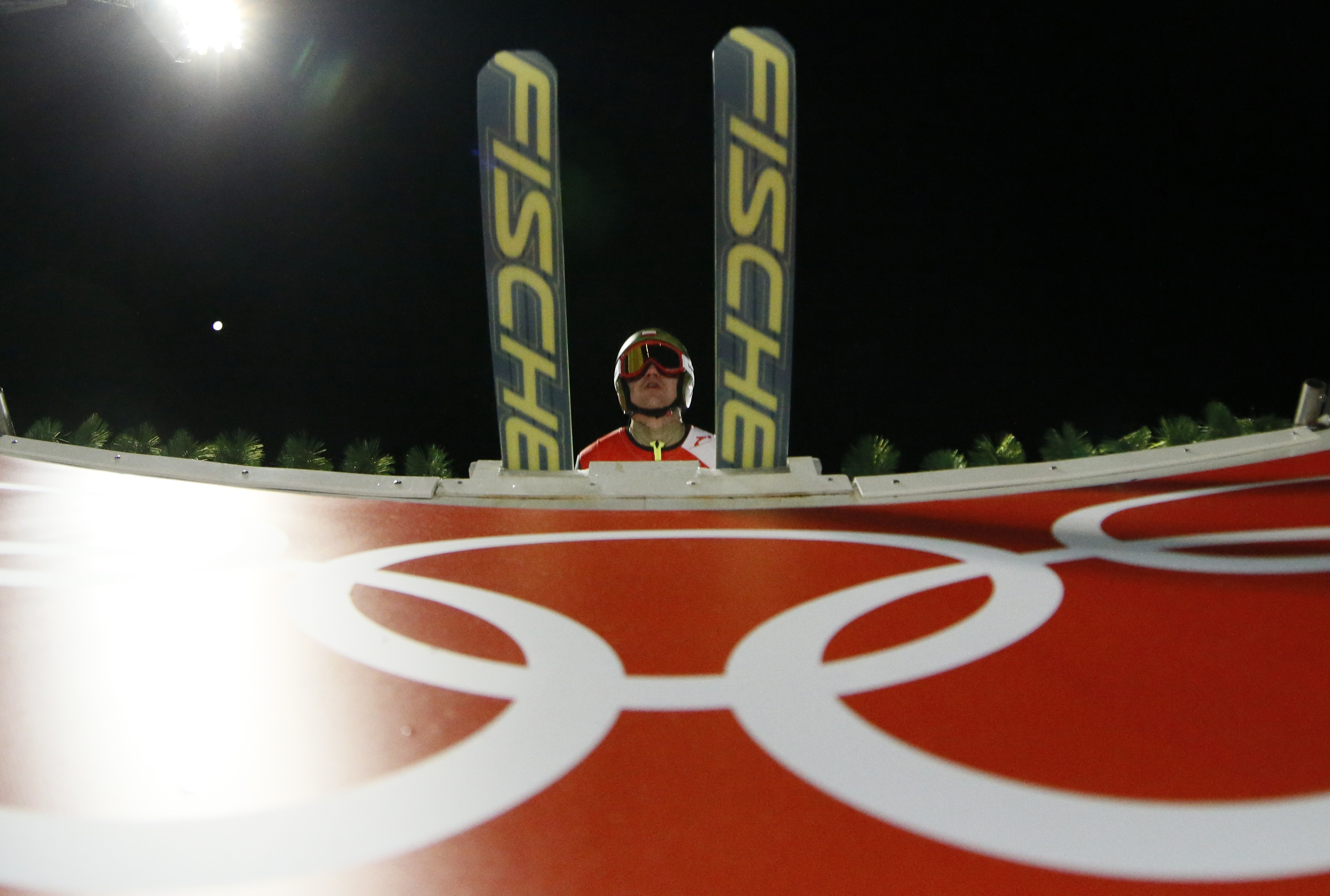 Poland's Kamil Stoch makes his jump during the men's large hill ski jumping training session at the 2014 Winter Olympics, Wednesday, Feb. 12, 2014, in Krasnaya Polyana, Russia. (AP Photo/Dmitry Lovetsky)