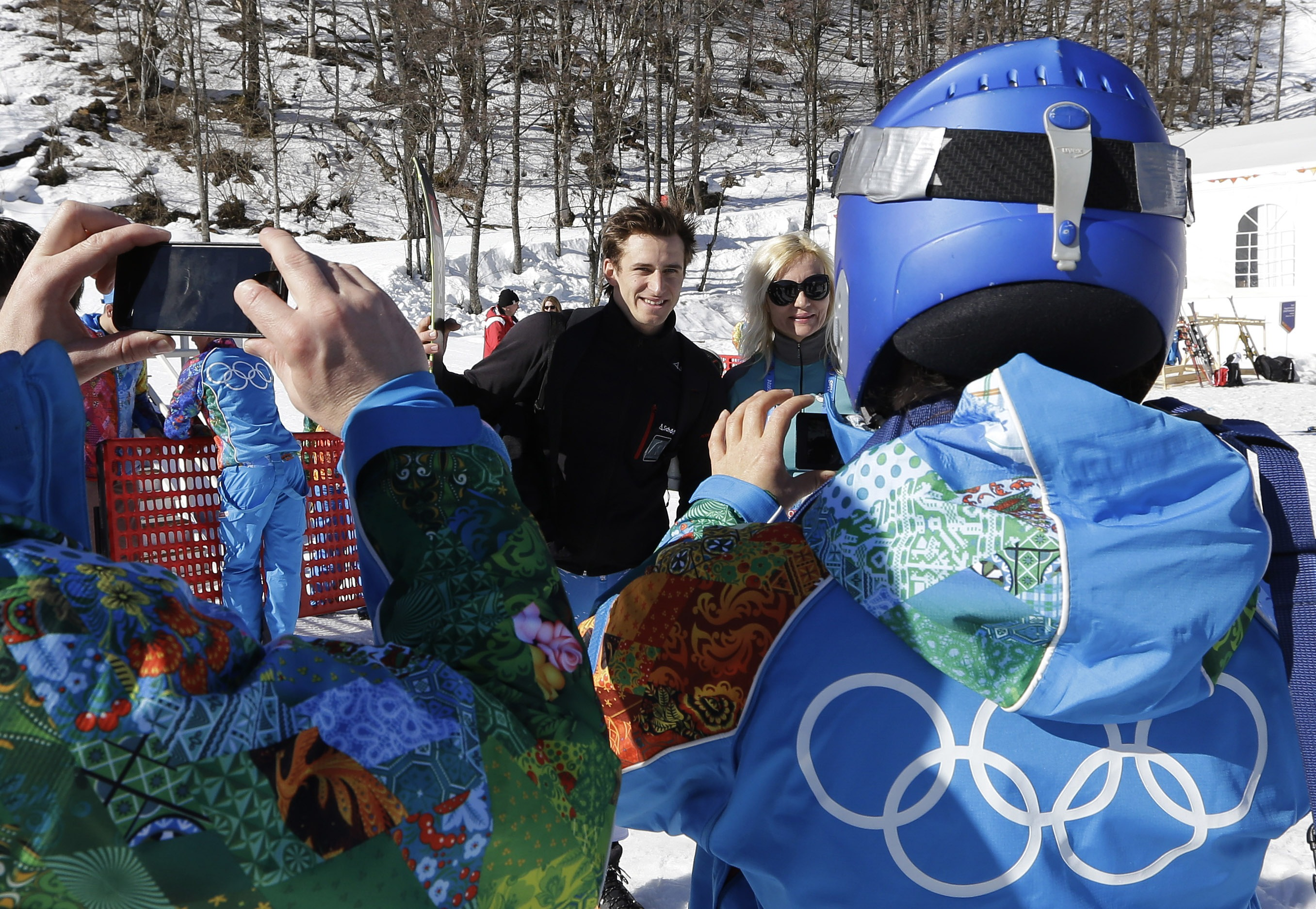 Austria's Matthias Mayer has his photo taken by volunteers near the finish area after completing men's downhill combined training at the Sochi 2014 Winter Olympics, Thursday, Feb. 13, 2014, in Krasnaya Polyana, Russia.  (AP Photo/Luca Bruno)