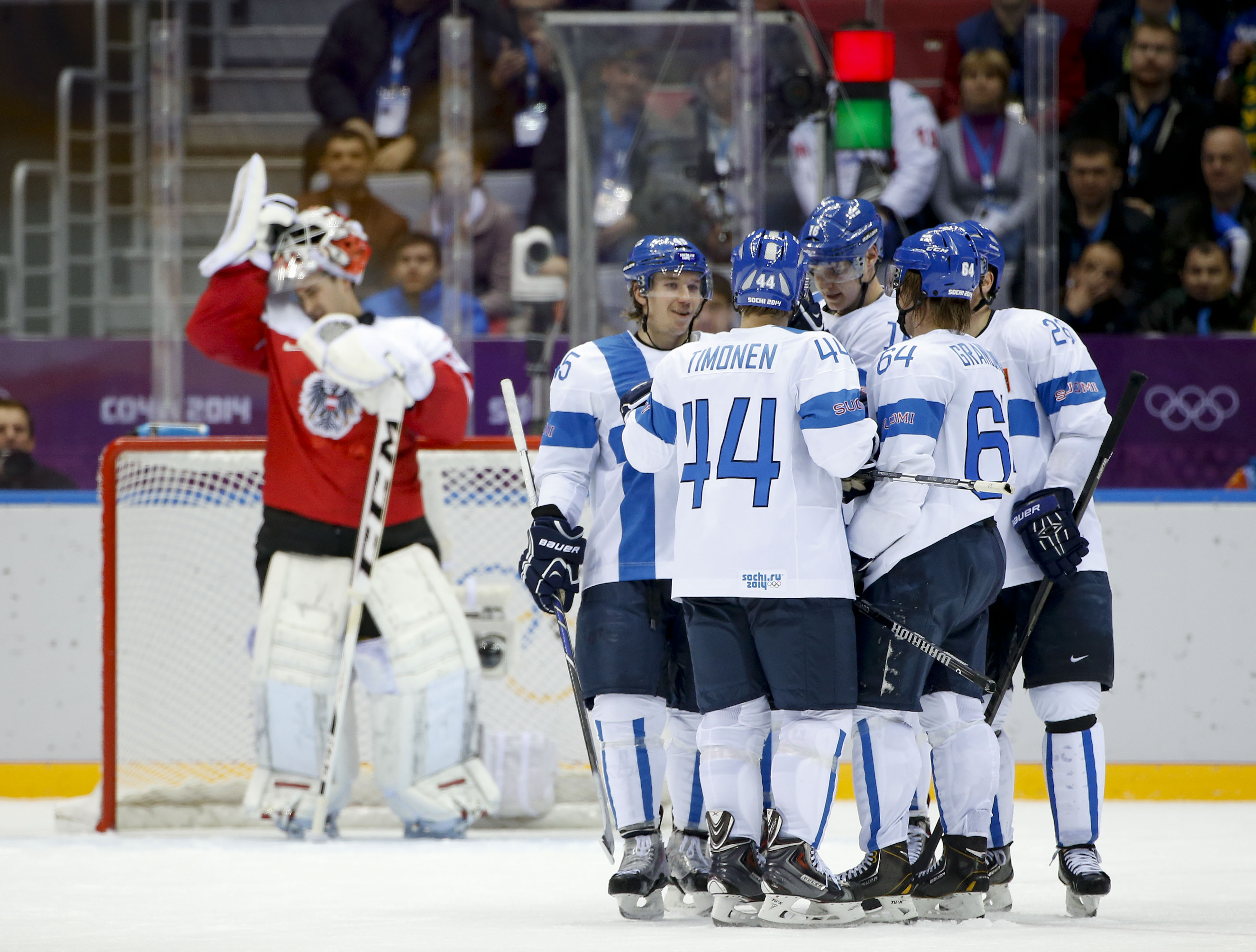 Team Finland celebrates after a third period goal against Austria in a men's ice hockey game at the 2014 Winter Olympics, Thursday, Feb. 13, 2014, in Sochi, Russia. Finland won 8-4. (AP Photo/Julio Cortez)