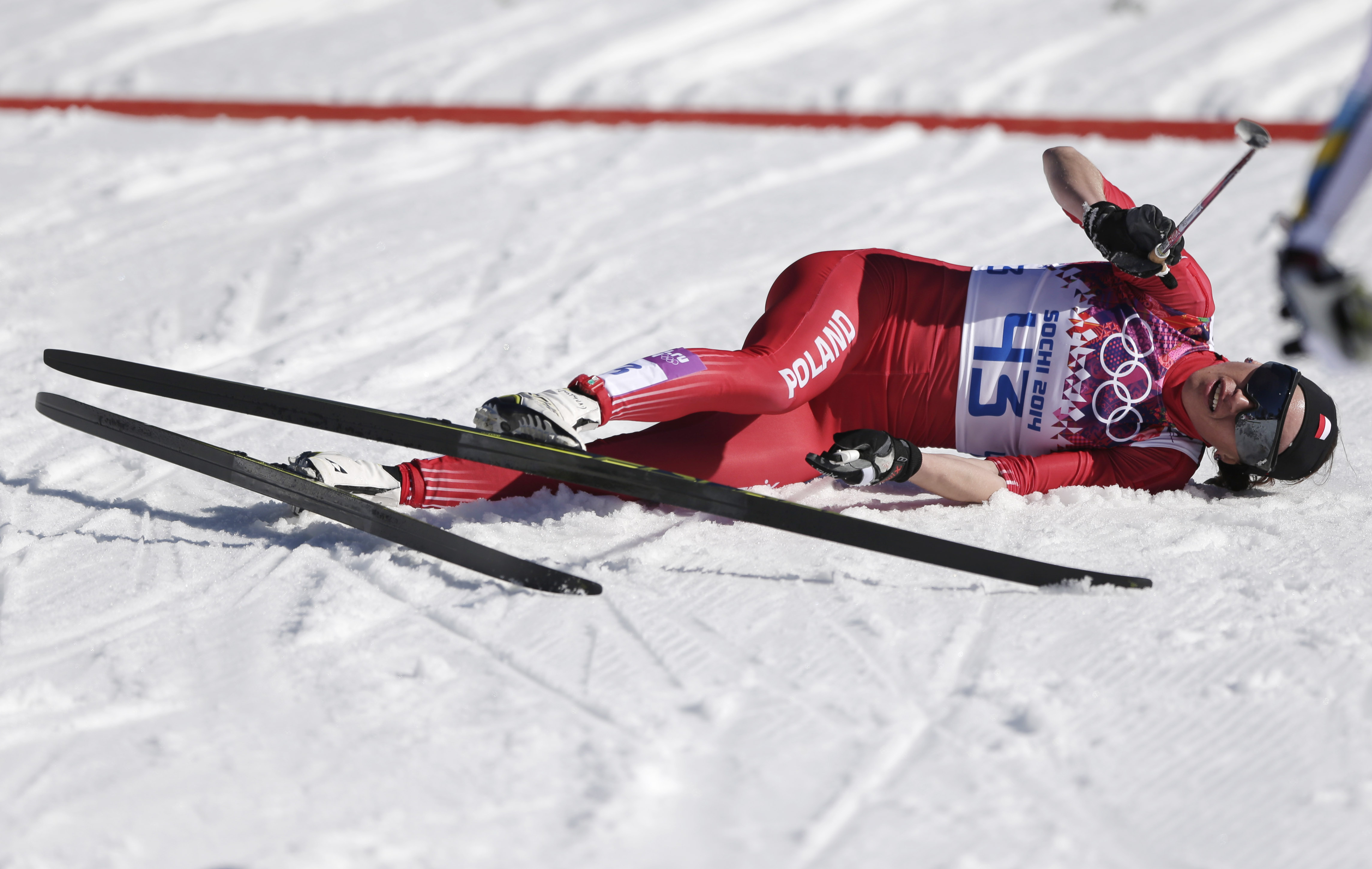 Poland's Justyna Kowalczyk catches her breath after winning the gold during the women's 10K classical-style cross-country race at the 2014 Winter Olympics, Thursday, Feb. 13, 2014, in Krasnaya Polyana, Russia. (AP Photo/Matthias Schrader)