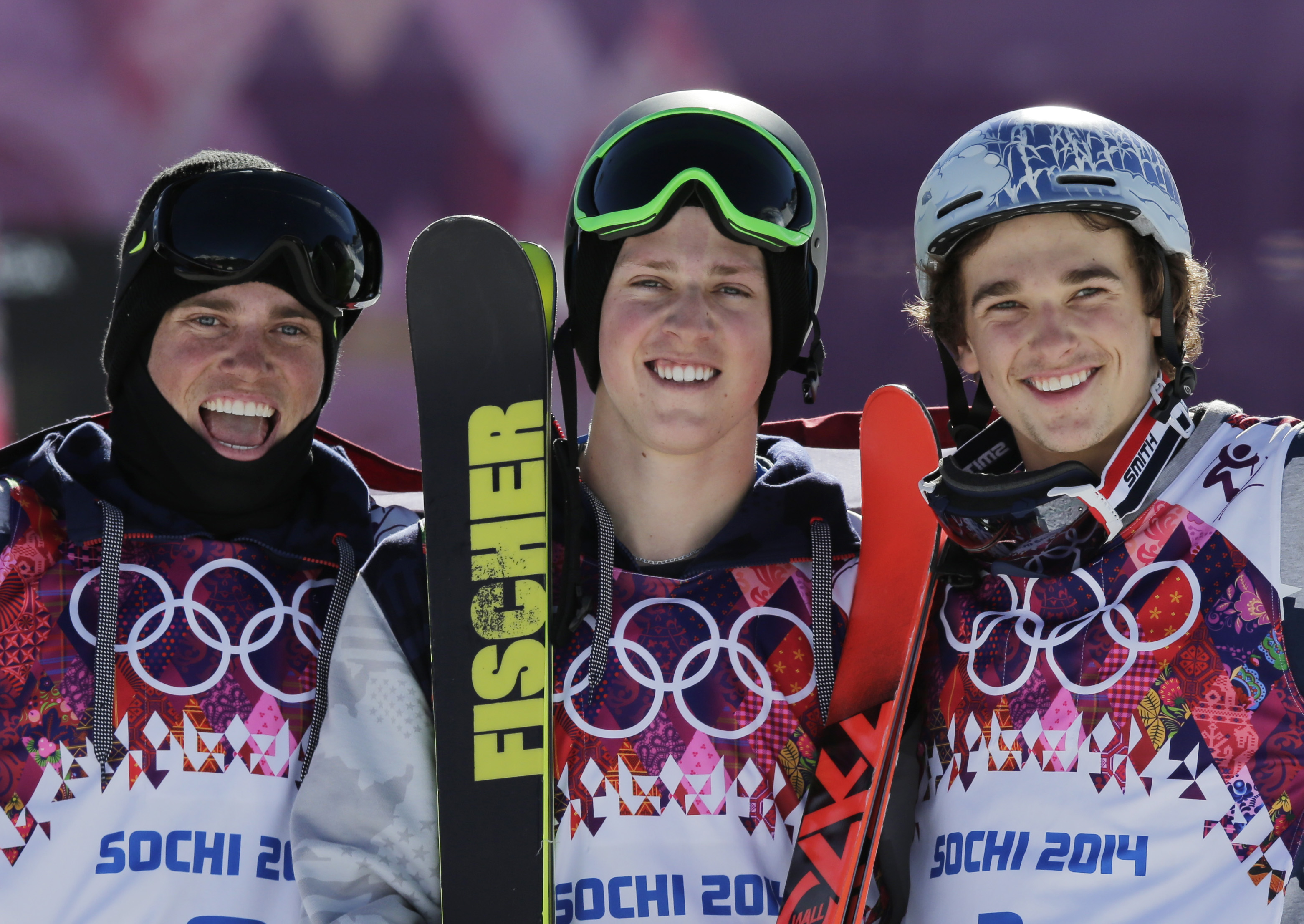 Men's ski slopestyle gold medal winner Joss Christensen of the United States, center, celebrates on the podium with his teammates Gus Kenworthy, left, silver, and Nicholas Goepper, bronze, right, during a flower ceremony at the Rosa Khutor Extreme Park, at the 2014 Winter Olympics, Thursday, Feb. 13, 2014, in Krasnaya Polyana, Russia.  (AP Photo/Andy Wong)