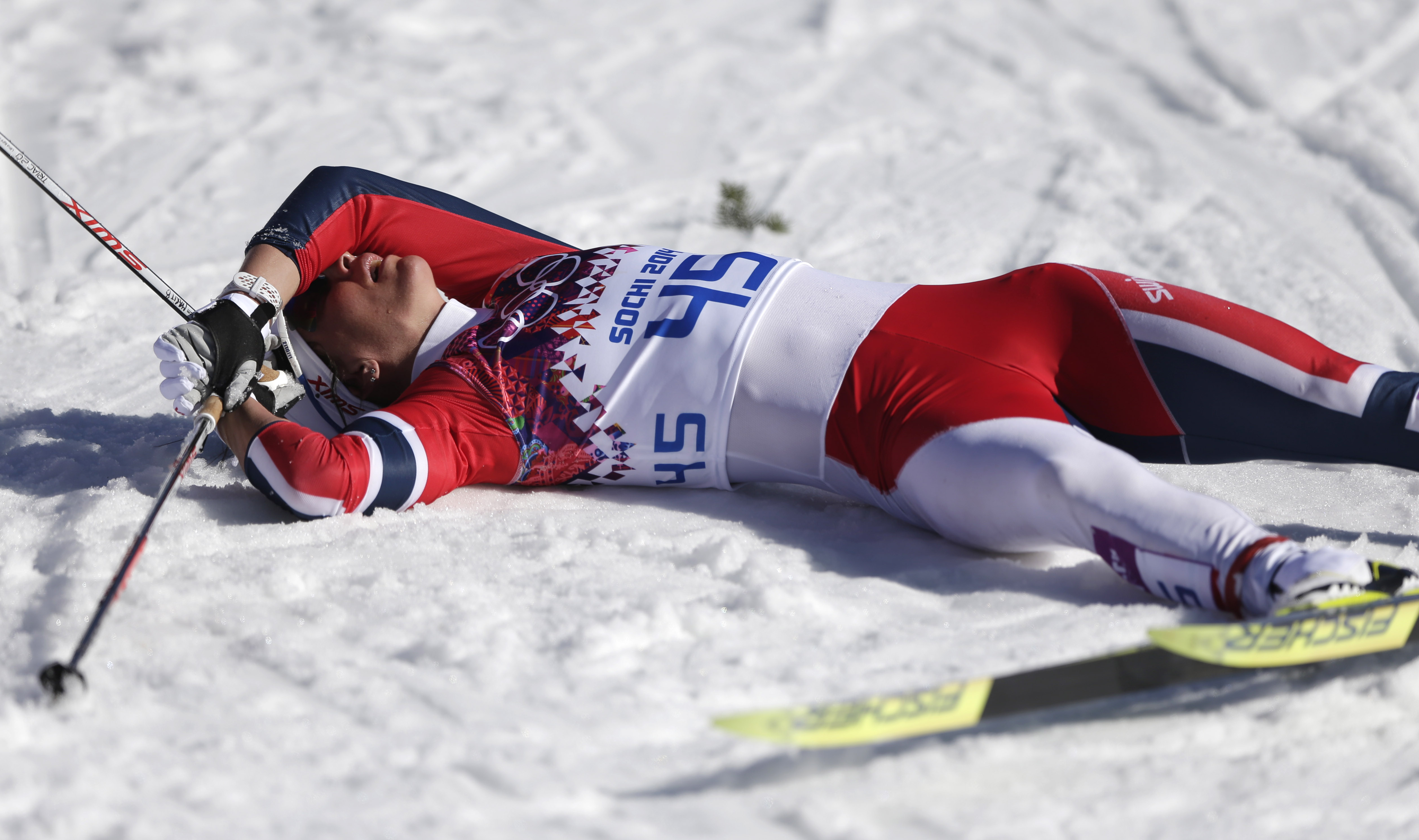 Norway's Marit Bjoergen catches her breath after the women's 10K classical-style cross-country race at the 2014 Winter Olympics, Thursday, Feb. 13, 2014, in Krasnaya Polyana, Russia. (AP Photo/Matthias Schrader)