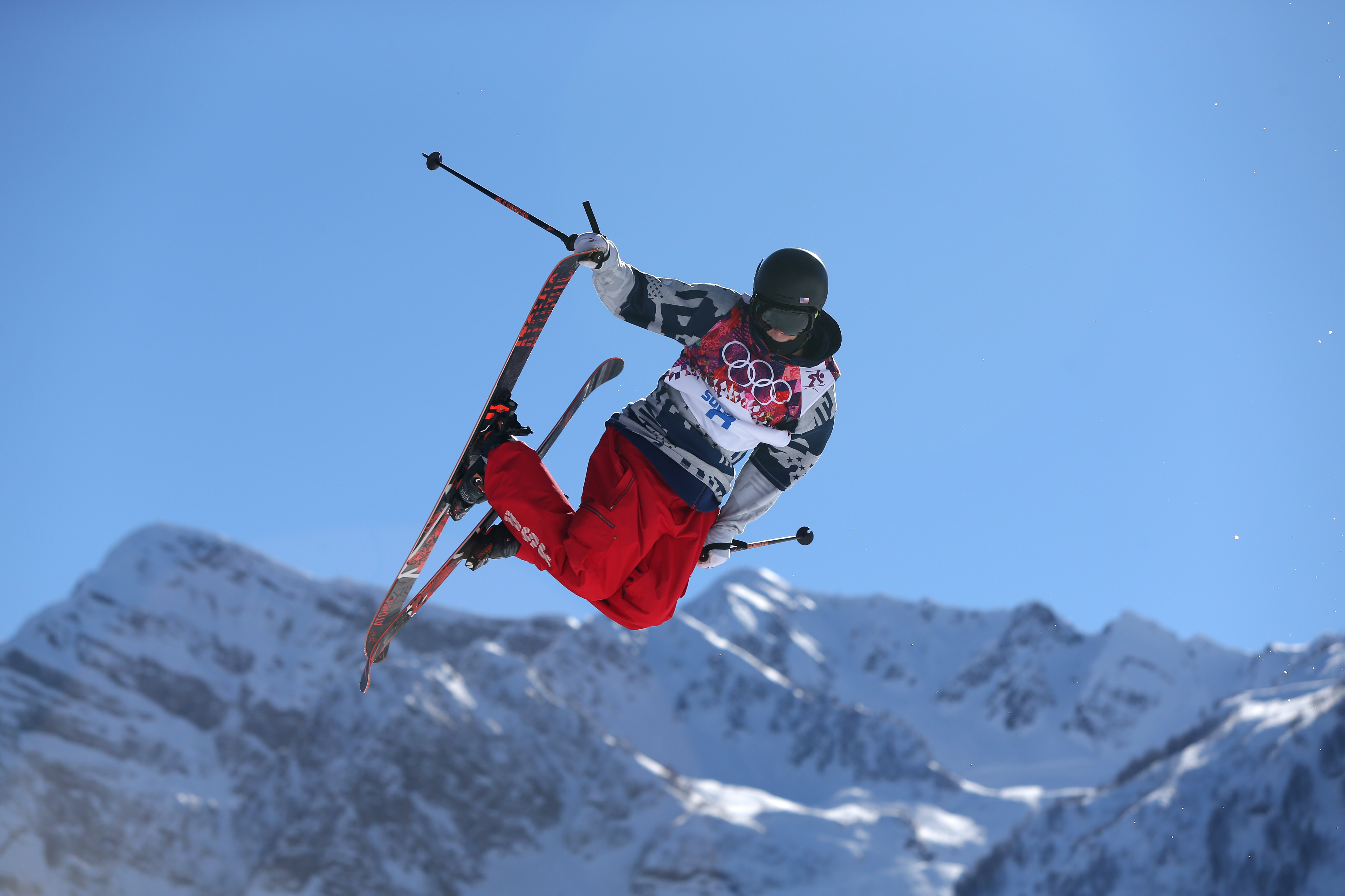 Gus Kenworthy of the United States competes in the men's ski slopestyle final to win the silver medal at the Rosa Khutor Extreme Park, at the 2014 Winter Olympics, Thursday, Feb. 13, 2014, in Krasnaya Polyana, Russia. (AP Photo/Sergei Grits)