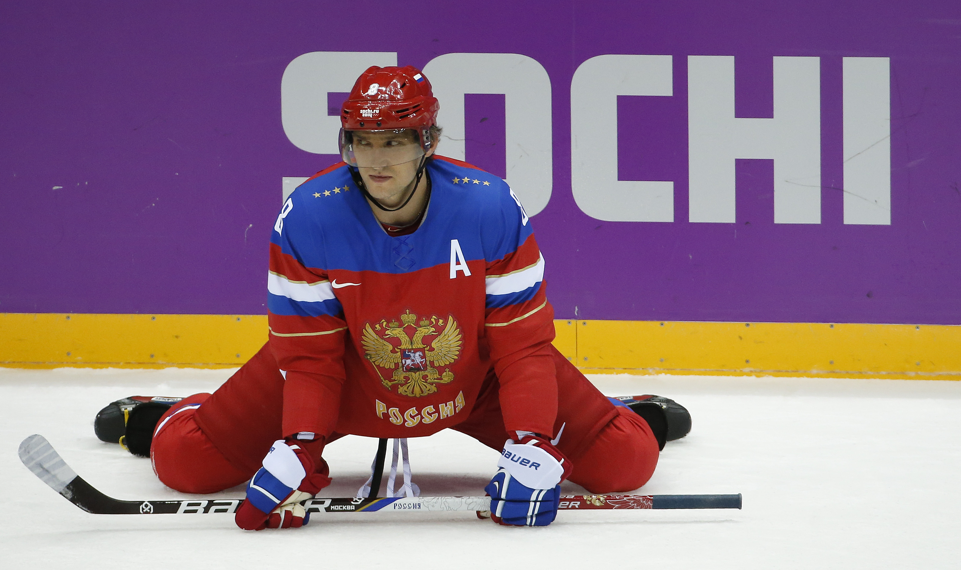 Russia forward Alexander Ovechkin stretches before playing against Slovenia in a men's ice hockey game at the 2014 Winter Olympics, Thursday, Feb. 13, 2014, in Sochi, Russia. (AP Photo/Mark Humphrey)