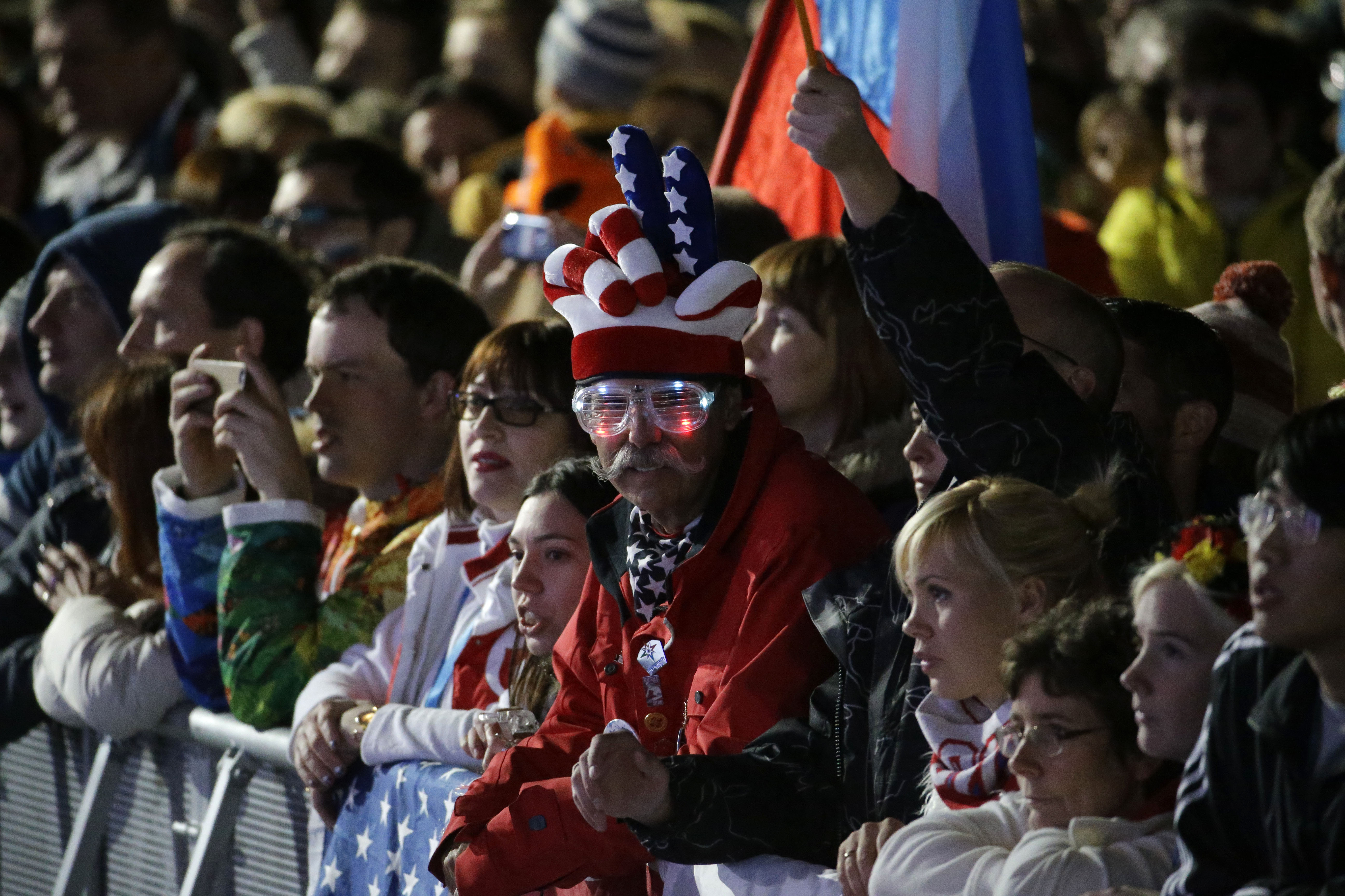 Fans gather before the medal ceremonies begin at the 2014 Winter Olympics, Thursday, Feb. 13, 2014, in Sochi, Russia. (AP Photo/Morry Gash)