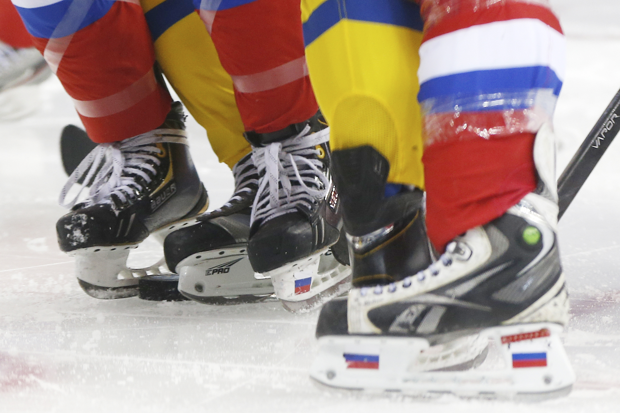 Members of Team Russian and Team Sweden line up for a face off during the 2014 Winter Olympics women's ice hockey game at Shayba Arena, Thursday, Feb. 13, 2014, in Sochi, Russia. (AP Photo/Petr David Josek)