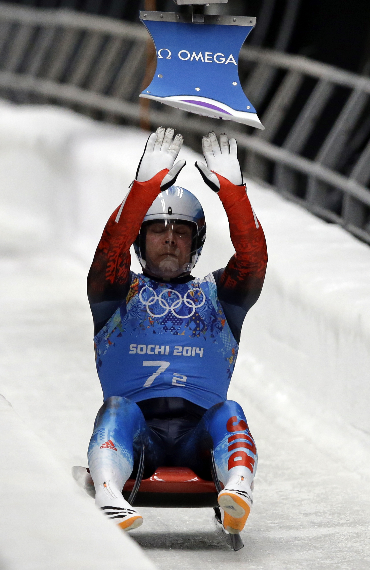 Russia's Albert Demchenko hits the relay pad so the doubles team can start their run during the luge team relay competition at the 2014 Winter Olympics, Thursday, Feb. 13, 2014, in Krasnaya Polyana, Russia. Russia won the silver medal. (AP Photo/Dita Alangkara)