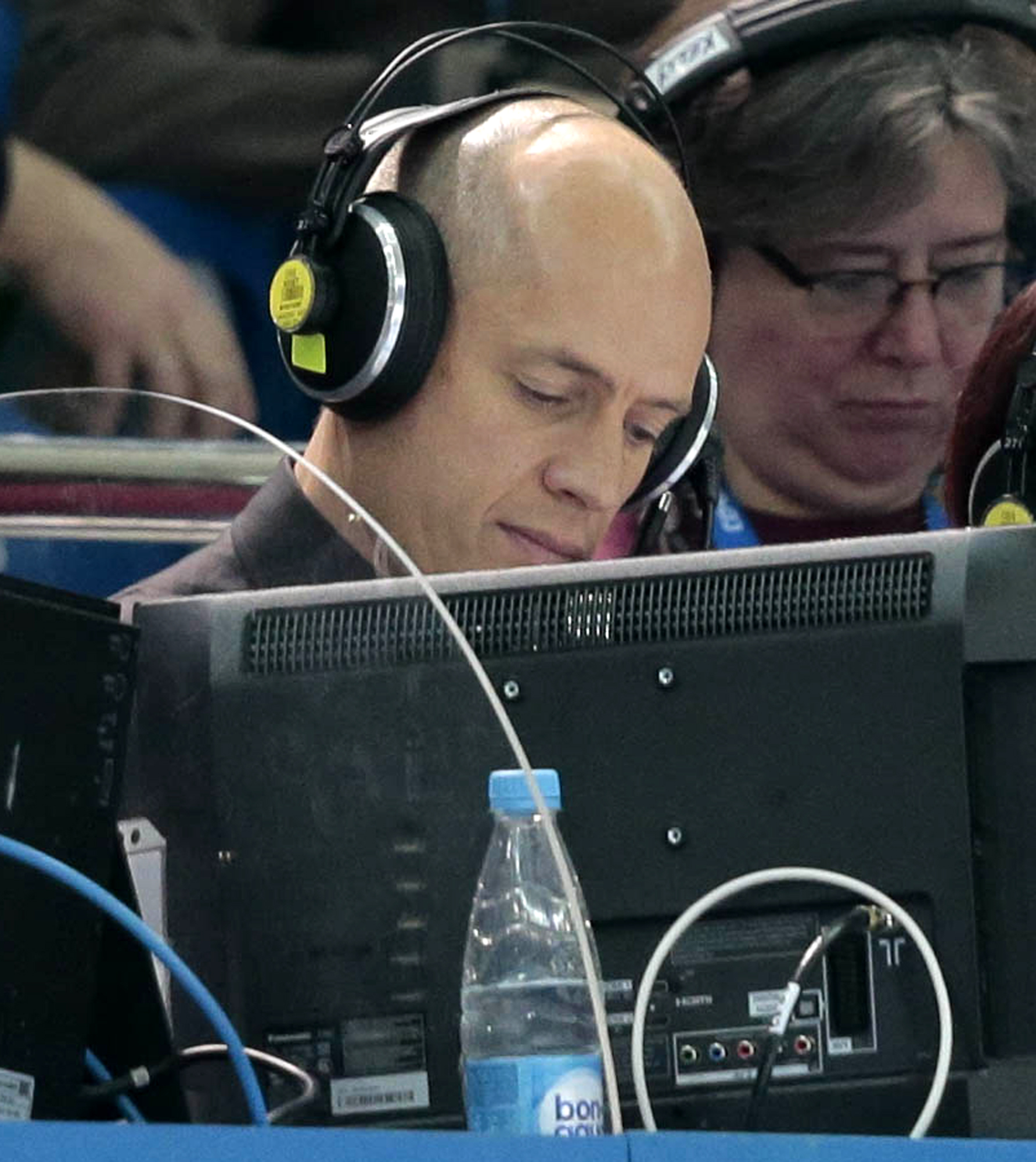 """In this Feb. 13, 2014 photo, former U.S. Olympic figure skater Scott Hamilton works as a commentator for NBC television during the men's short program figure skating competition at the 2014 Winter Olympics in Sochi, Russia. Thirty years ago, Hamilton won the figure skating gold medal in Sarajevo. His victory was the culmination of a four-year winning streak that would seem impossible nowadays. """"Everything I did in those four years peaked at the Olympics,"""" he says. (AP Photo/Ivan Sekretarev)"""