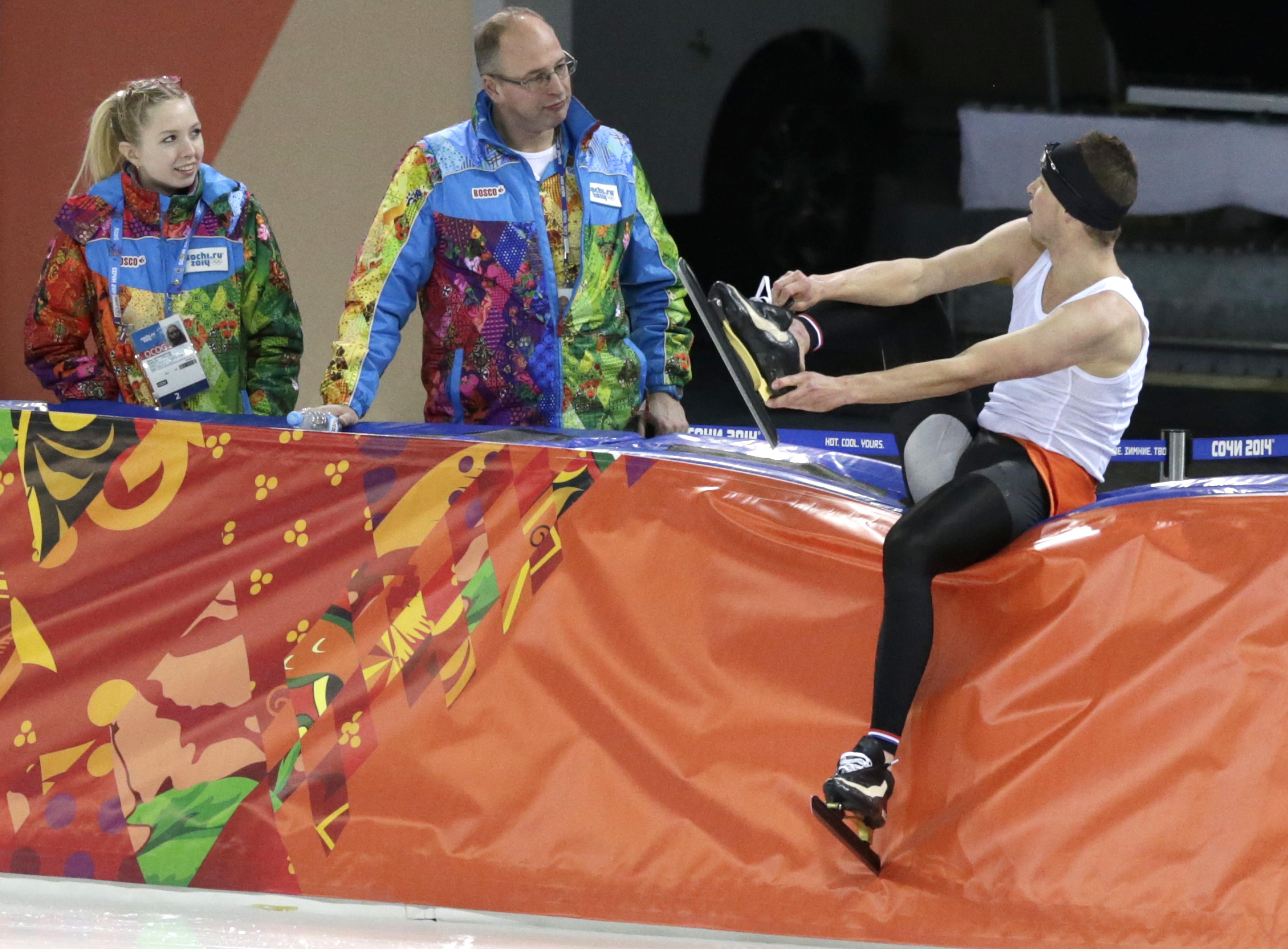 Sven Kramer of the Netherlands talks to volunteers at the Adler Arena Skating Center at the 2014 Winter Olympics, Friday, Feb. 14, 2014, in Sochi, Russia. (AP Photo/Matt Dunham)