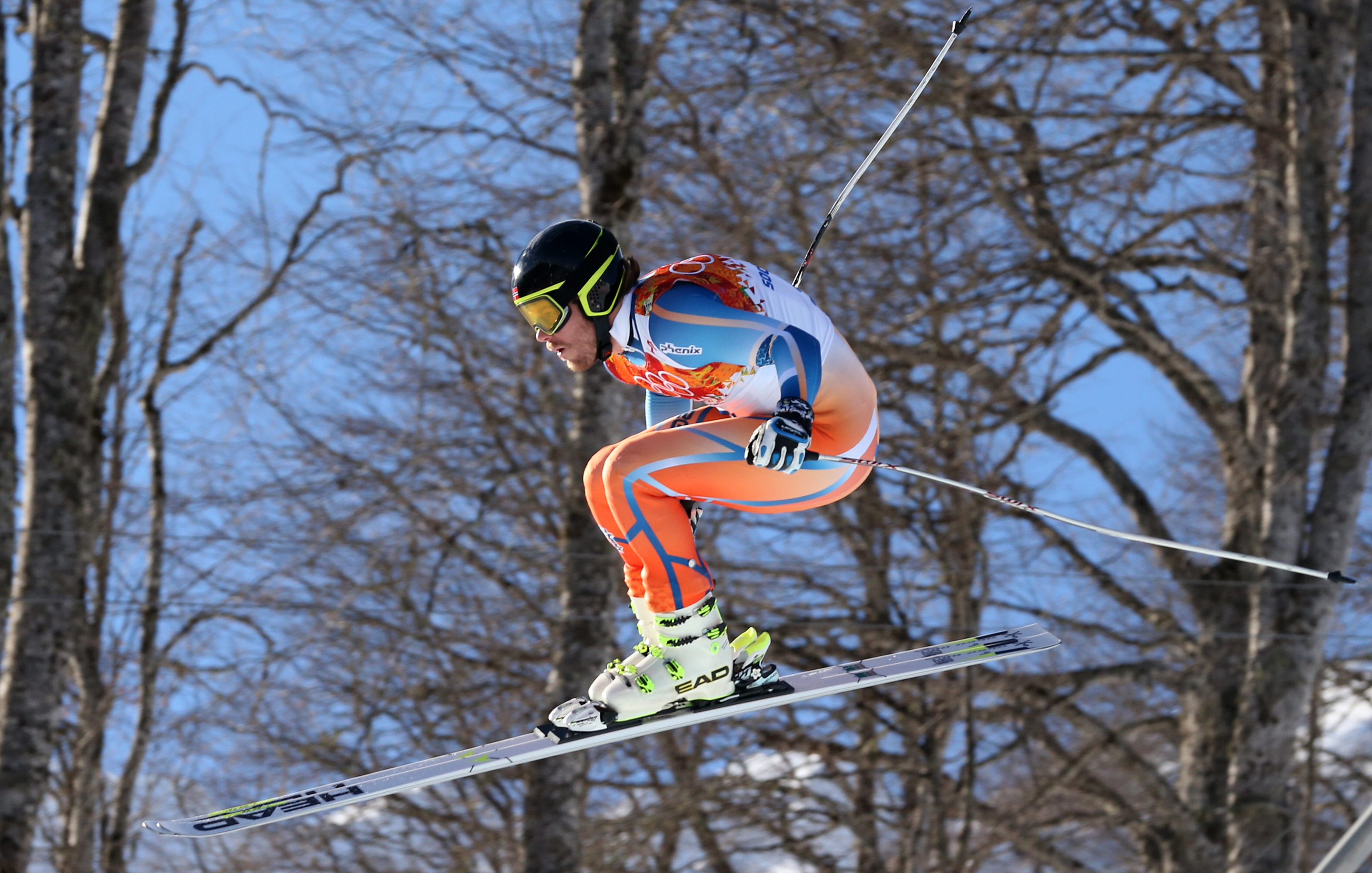 Norway's Kjetil Jansrud makes a jump during the downhill portion of the men's supercombined at the Sochi 2014 Winter Olympics, Friday, Feb. 14, 2014, in Krasnaya Polyana, Russia. (AP Photo/Luca Bruno)