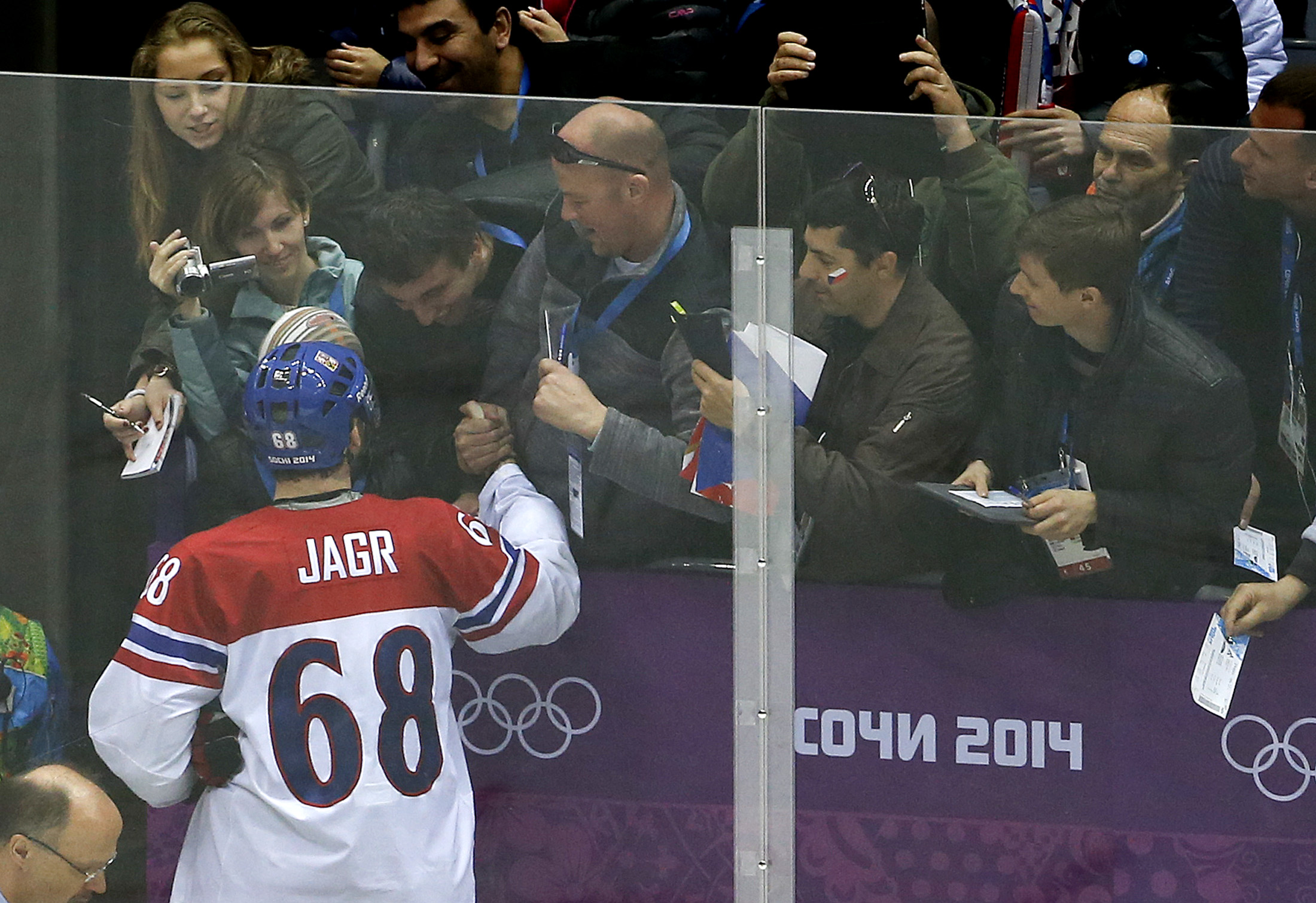 Czech Republic forward Jaromir Jagr greets fans after beating Latvia 4-2 during a men's ice hockey game at the 2014 Winter Olympics, Friday, Feb. 14, 2014, in Sochi, Russia. (AP Photo/Julio Cortez)