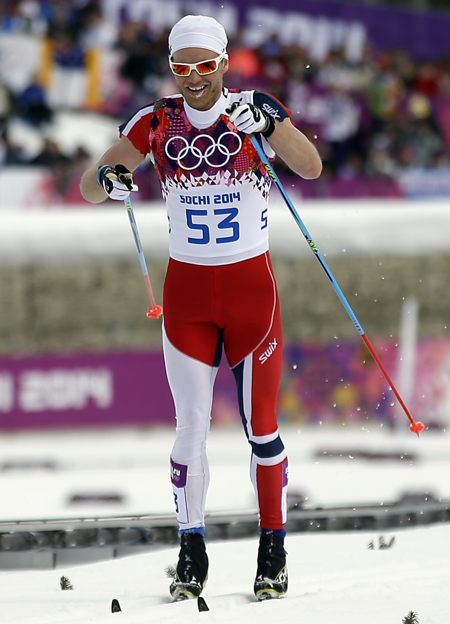 Norway's Martin Johnsrud Sundby competes with his sleeves cut, during the men's 15K classical-style cross-country race at the 2014 Winter Olympics, Friday, Feb. 14, 2014, in Krasnaya Polyana, Russia. (AP Photo/Gregorio Borgia)
