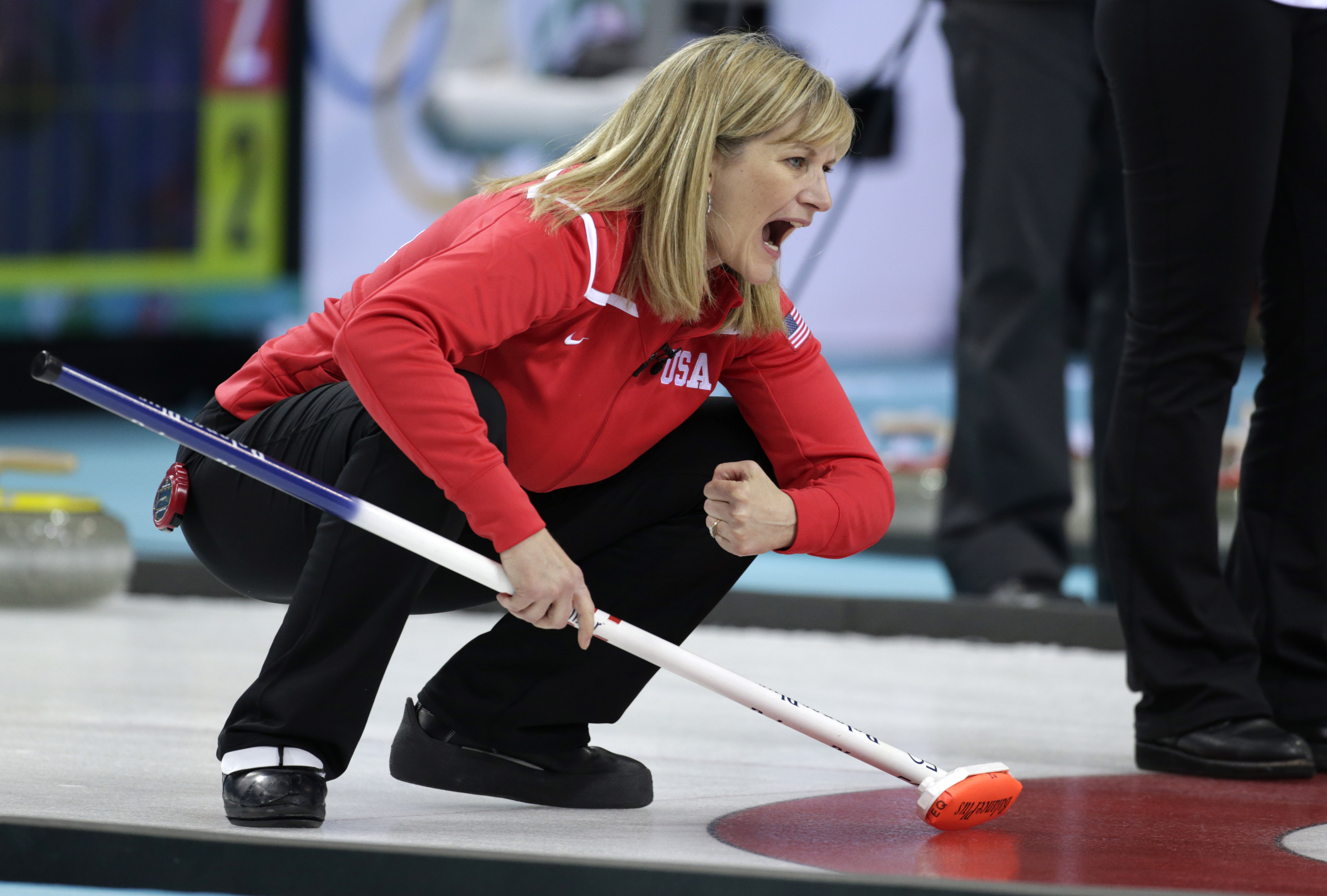 Erika Brown, skip of the United States team, shouts instructions from the house during women's curling competition against Denmark at the 2014 Winter Olympics, Friday, Feb. 14, 2014, in Sochi, Russia. (AP Photo/Robert F. Bukaty)