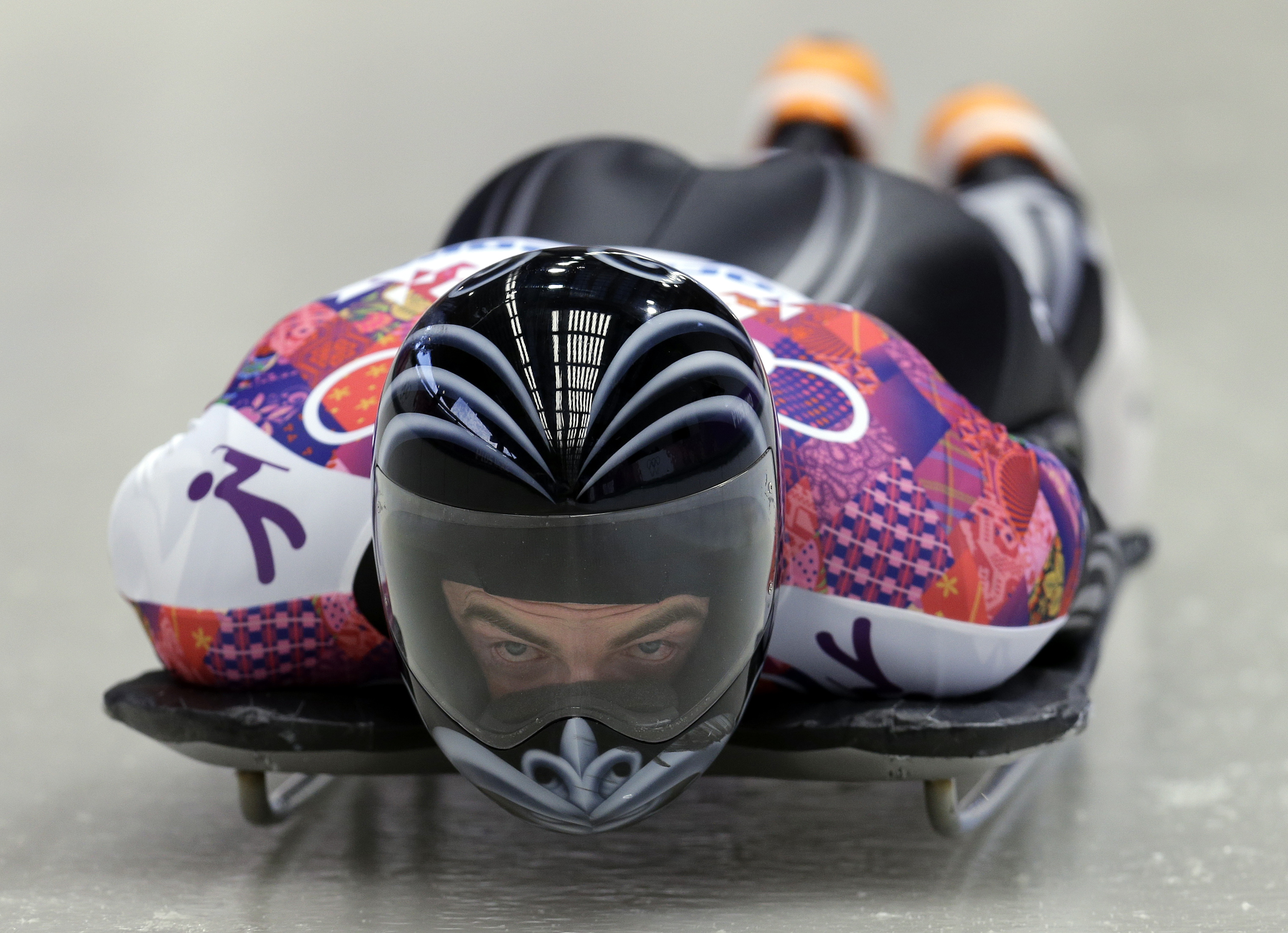 Ben Sandford of New Zealand starts his first run during the men's skeleton competition at the 2014 Winter Olympics, Friday, Feb. 14, 2014, in Krasnaya Polyana, Russia. (AP Photo/Natacha Pisarenko)