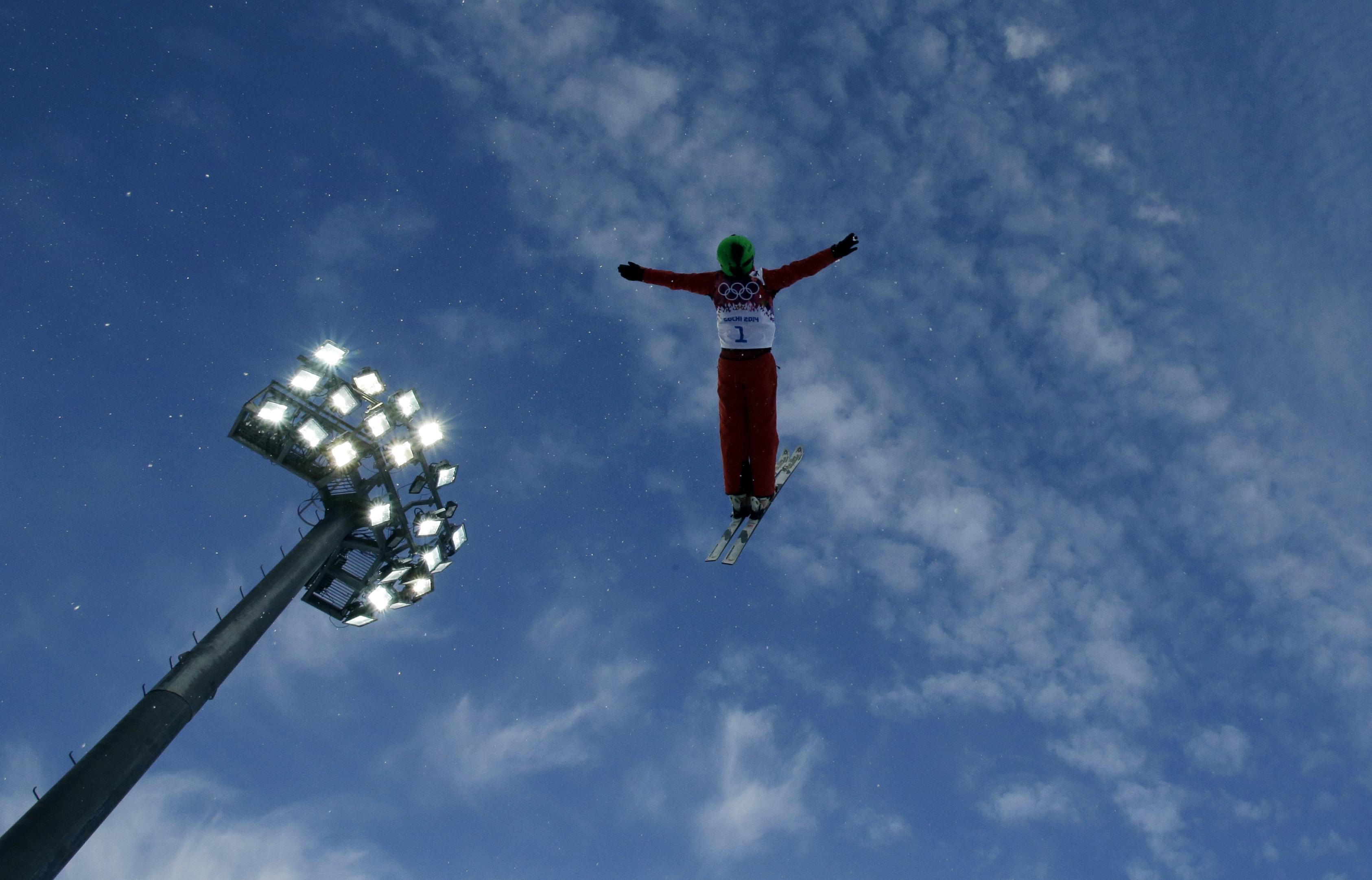 China's Li Nina jumps during women's freestyle skiing aerials training at the Rosa Khutor Extreme Park, at the 2014 Winter Olympics, Friday, Feb. 14, 2014, in Krasnaya Polyana, Russia. (AP Photo/Greg Baker)