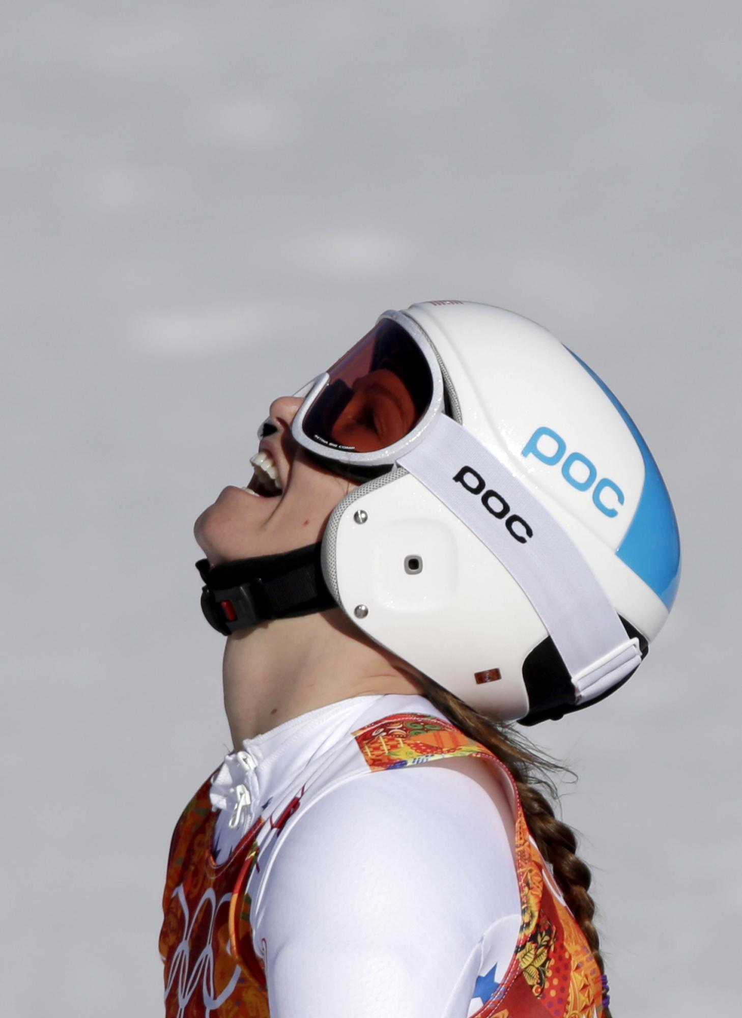 United States' Julia Mancuso catches her breath at the end of the women's super-G at the Sochi 2014 Winter Olympics, Saturday, Feb. 15, 2014, in Krasnaya Polyana, Russia. (AP Photo/Gero Breloer)