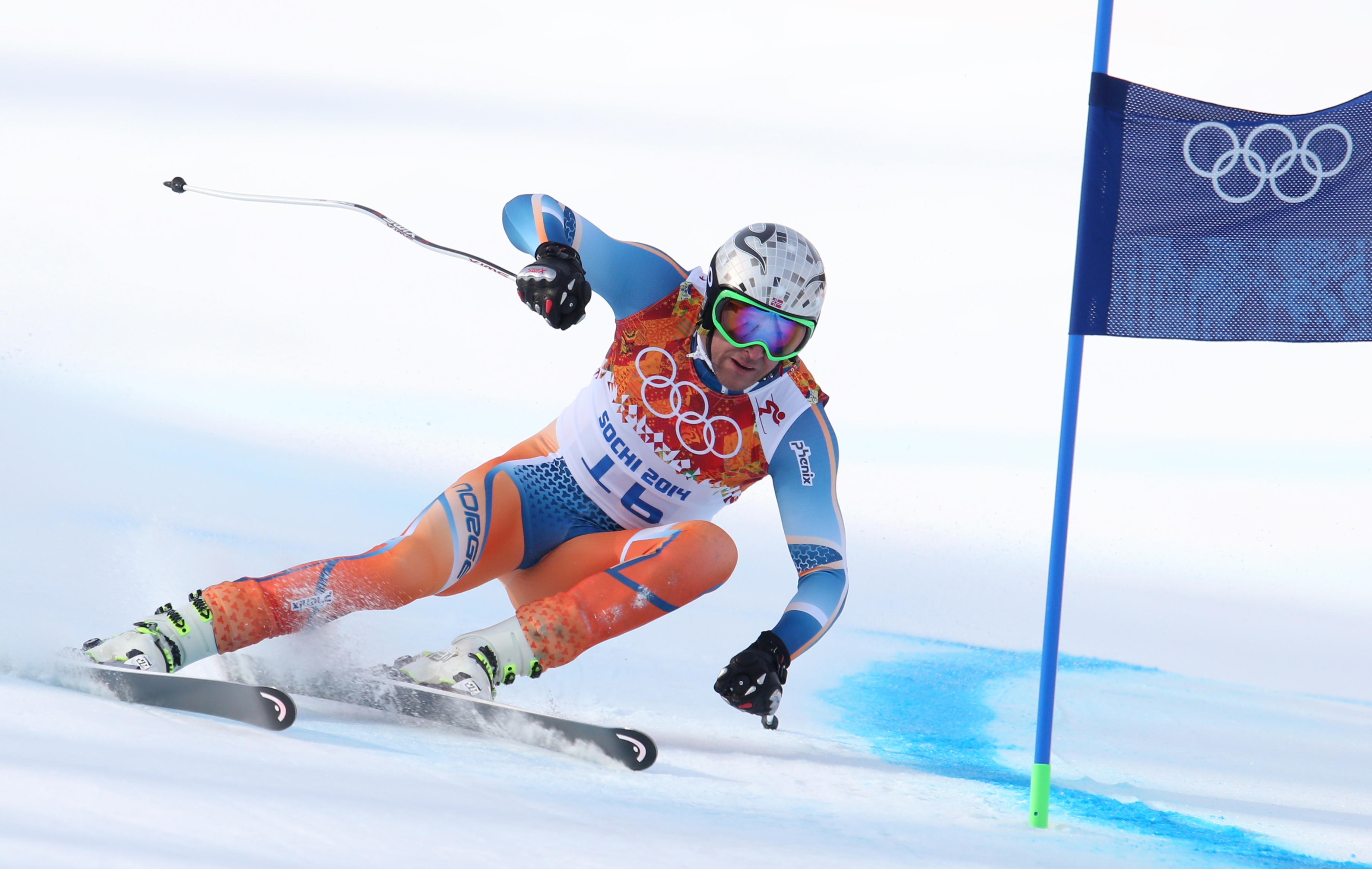 Norway's Aksel Lund Svindal passes a gate in the men's super-G the Sochi 2014 Winter Olympics, Sunday, Feb. 16, 2014, in Krasnaya Polyana, Russia. (AP Photo/Alessandro Trovati)