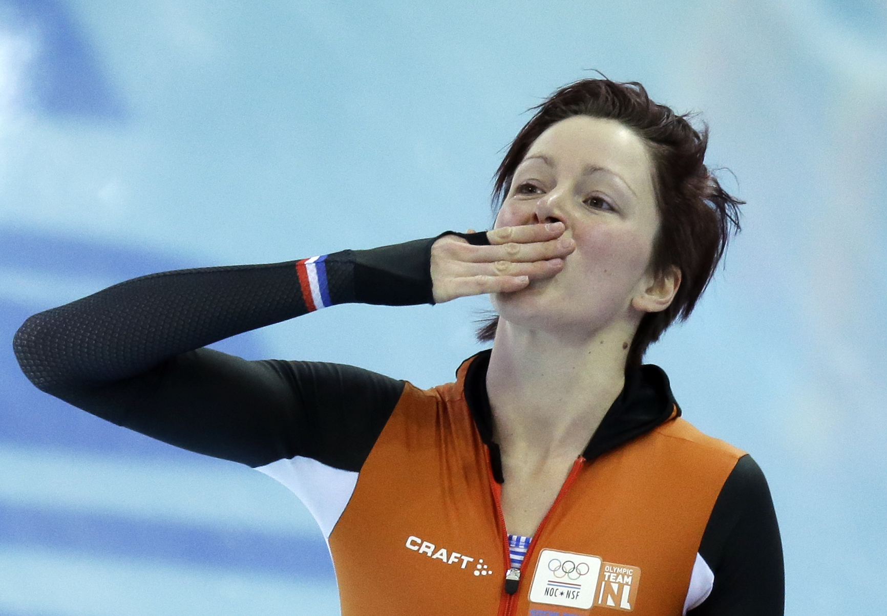 Jorien ter Mors of the Netherlands acknowledges the crowd after setting a new Olympic record in the women's 1,500-meter race at the Adler Arena Skating Center during the 2014 Winter Olympics in Sochi, Russia, Sunday, Feb. 16, 2014. (AP Photo/David J. Phillip )