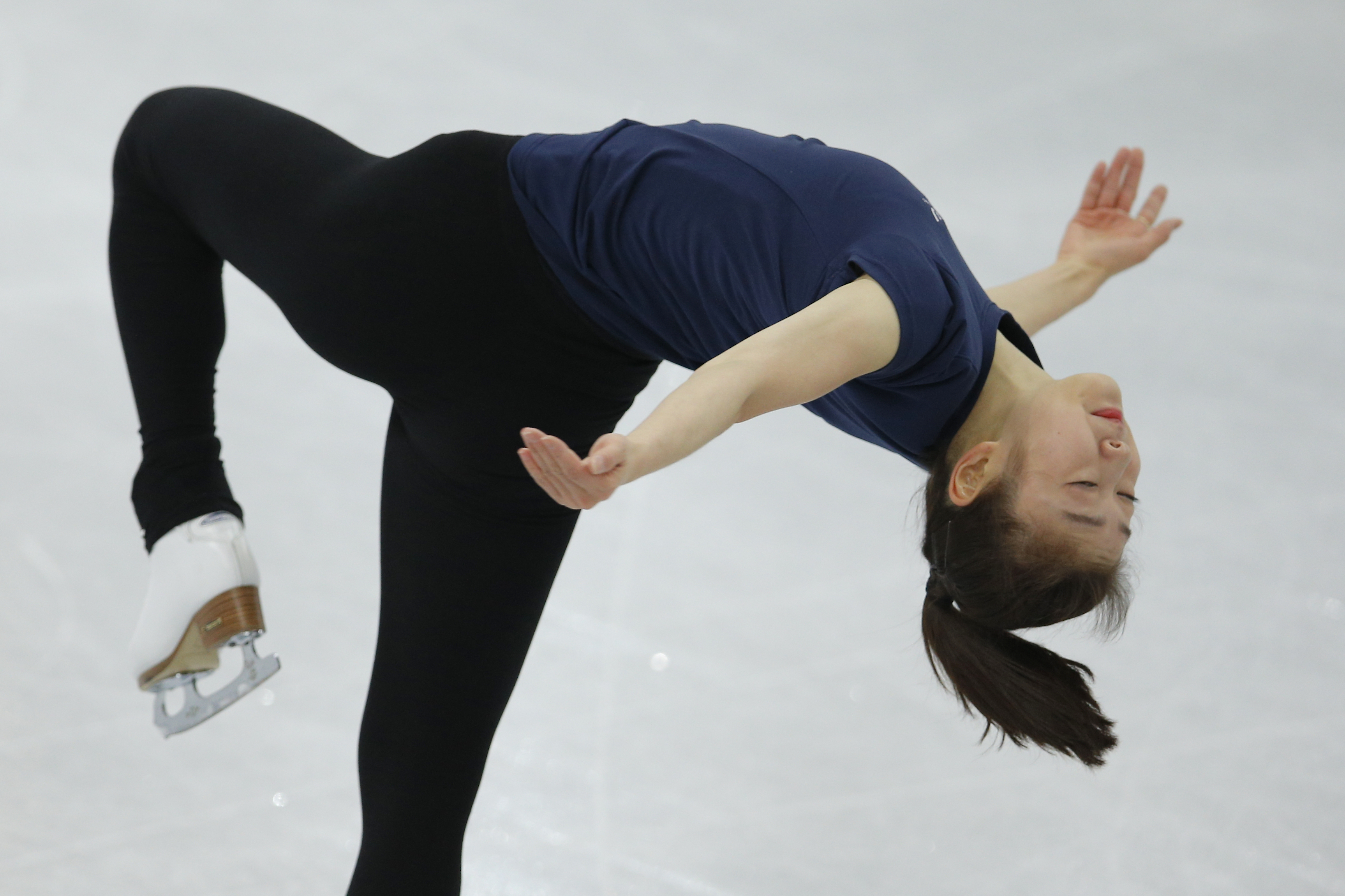Yuna Kim of South Korea skates during a practice session at the figure stating practice rink at the 2014 Winter Olympics, Monday, Feb. 17, 2014, in Sochi, Russia. (AP Photo/Vadim Ghirda)