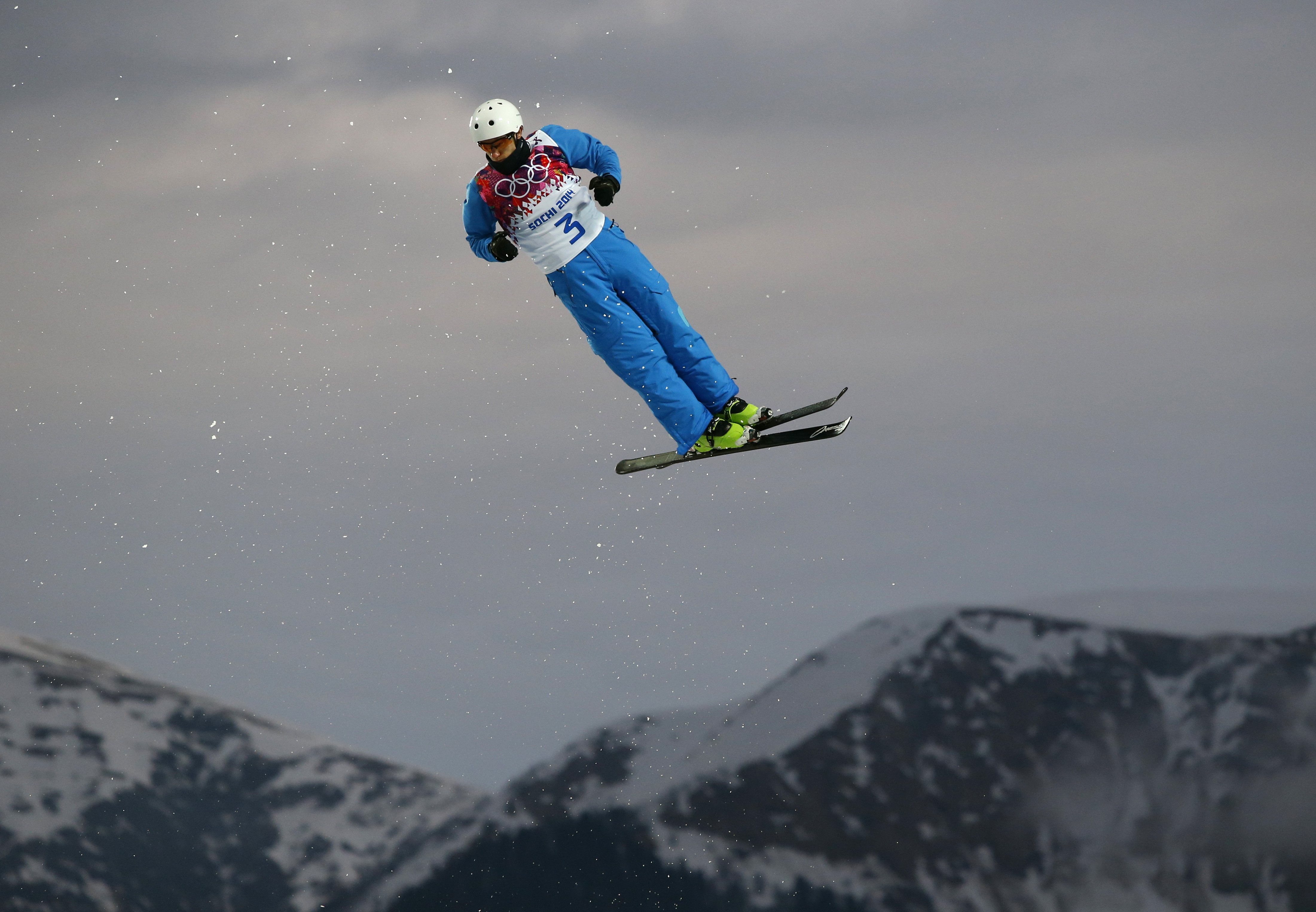 Anton Kushnir of Belarus jumps during men's freestyle skiing aerials qualifying at the Rosa Khutor Extreme Park, at the 2014 Winter Olympics, Monday, Feb. 17, 2014, in Krasnaya Polyana, Russia.(AP Photo/Sergei Grits)
