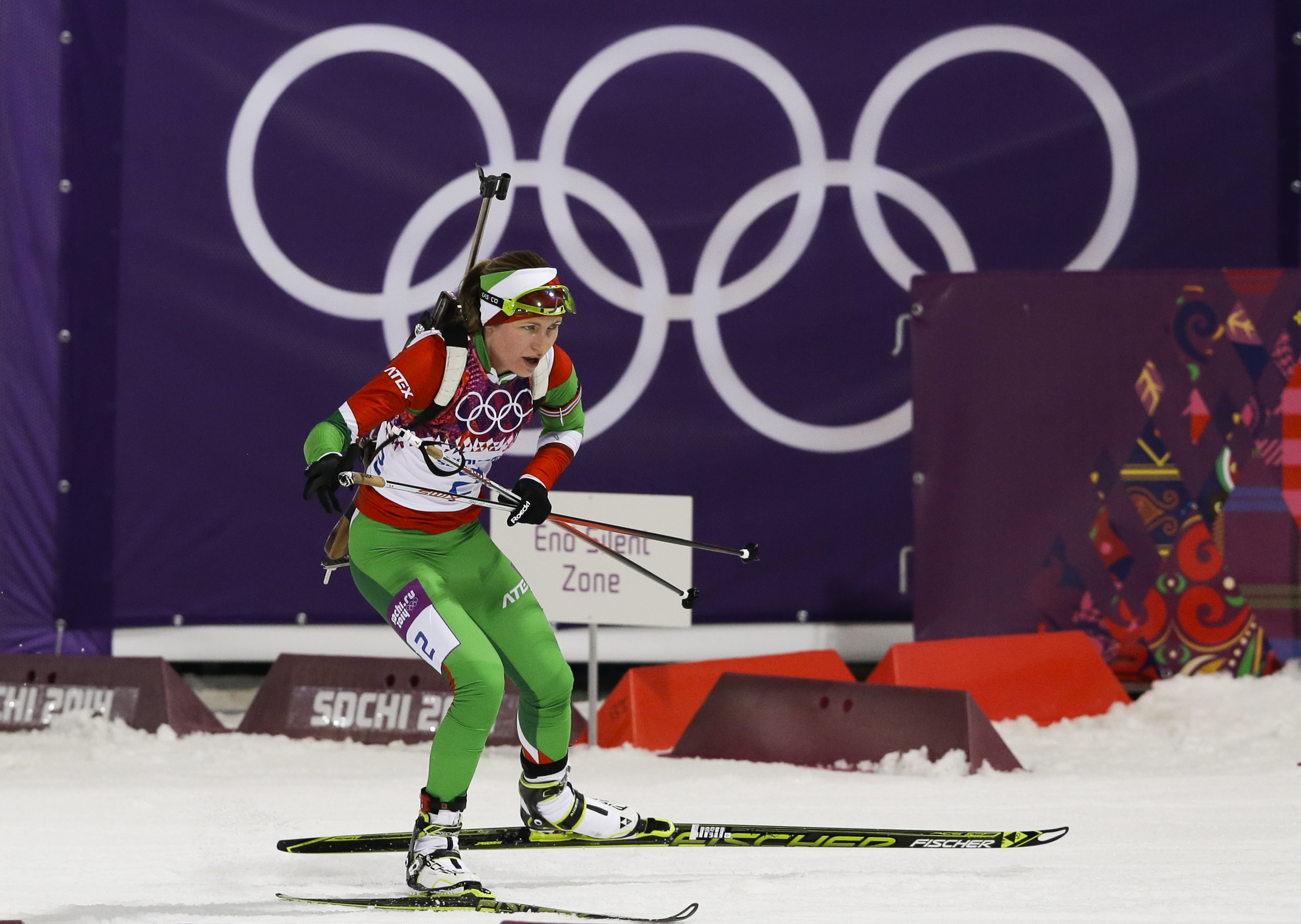 Belarus' Darya Domracheva skies on her way to win the gold medal in the women's biathlon 12.5k mass-start, at the 2014 Winter Olympics, Monday, Feb. 17, 2014, in Krasnaya Polyana, Russia. (AP Photo/Kirsty Wigglesworth)