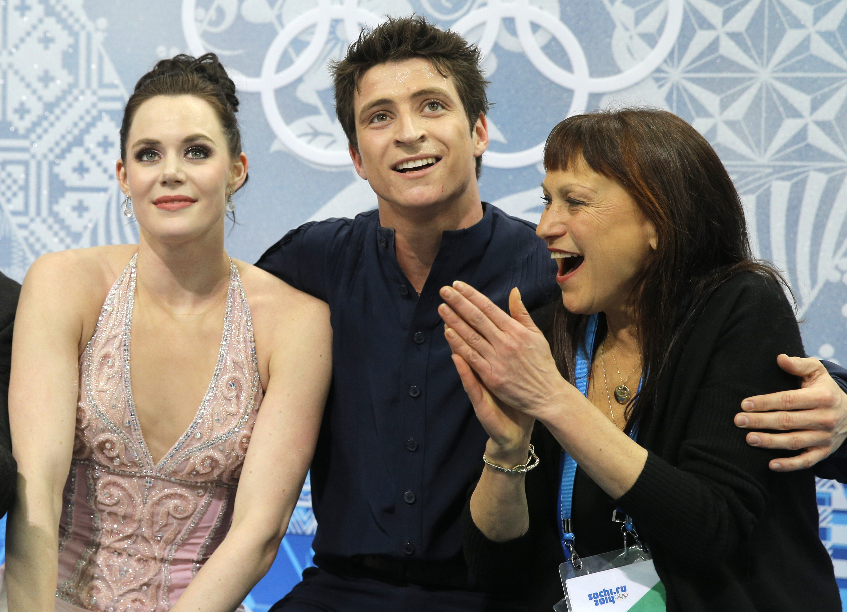 Tessa Virtue and Scott Moir of Canada and their coach Marina Zueva, right, wait in the results area after competing in the ice dance free dance figure skating finals at the Iceberg Skating Palace during the 2014 Winter Olympics, Monday, Feb. 17, 2014, in Sochi, Russia. (AP Photo/Vadim Ghirda)
