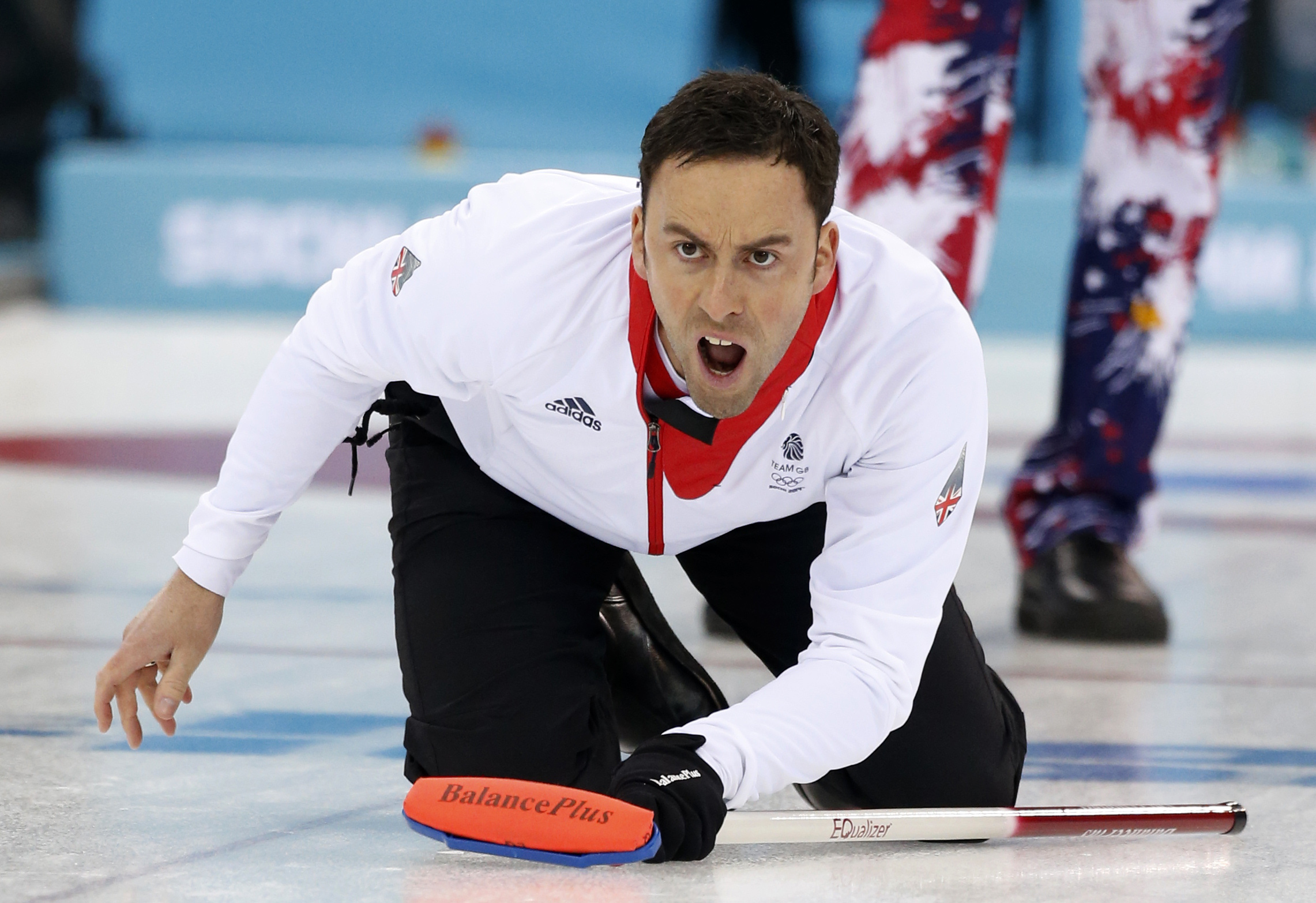 Britain's skip David Murdoch shouts instructions after delivering the stone during a tiebreaker game against Norway in men's curling competition against at the 2014 Winter Olympics, Tuesday, Feb. 18, 2014, in Sochi, Russia. (AP Photo/Robert F. Bukaty)