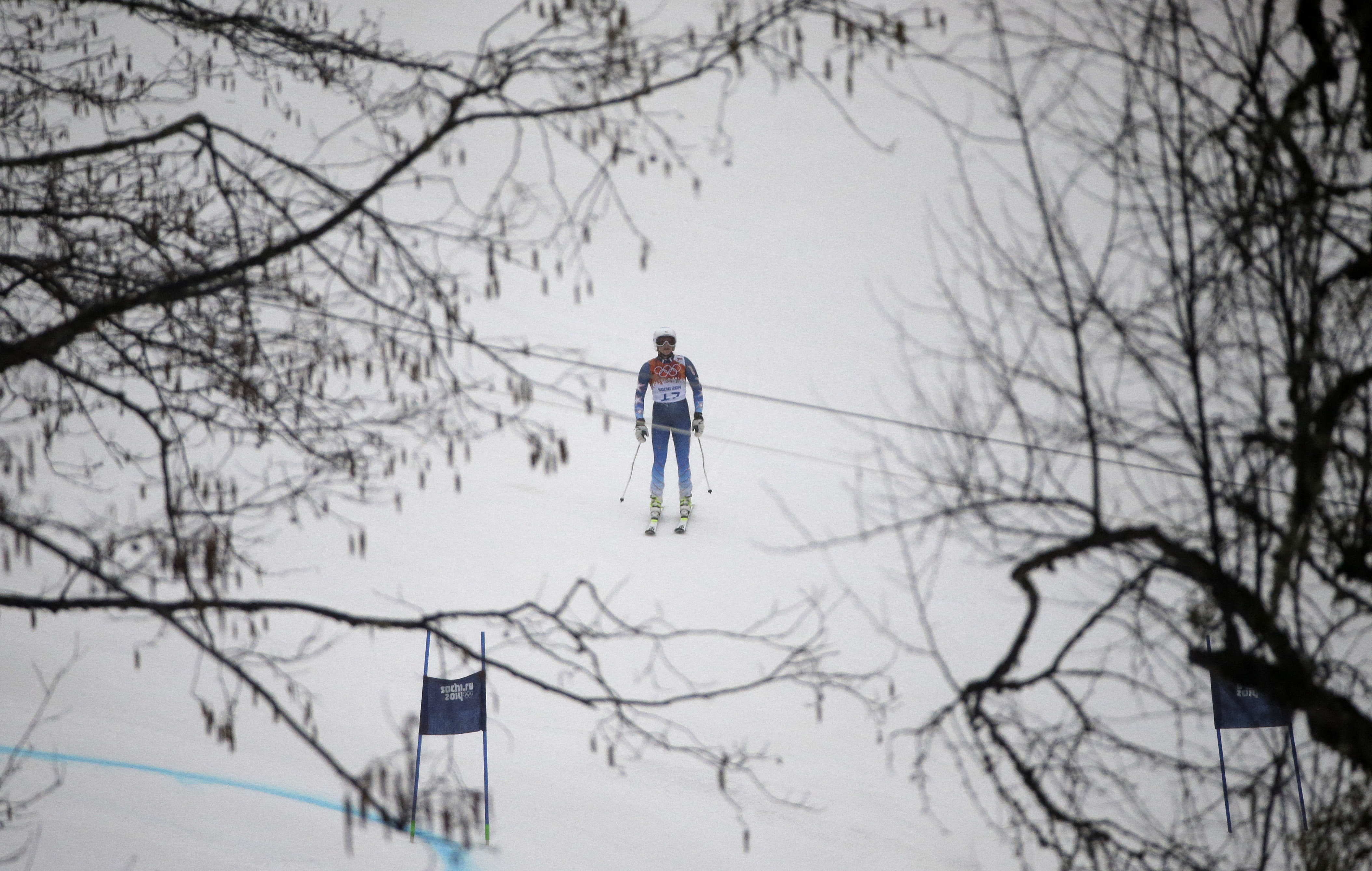 United States' Julia Mancuso pauses on the course after skiing out of the first run of the women's giant slalom at the Sochi 2014 Winter Olympics, Tuesday, Feb. 18, 2014, in Krasnaya Polyana, Russia. (AP Photo/Gero Breloer)
