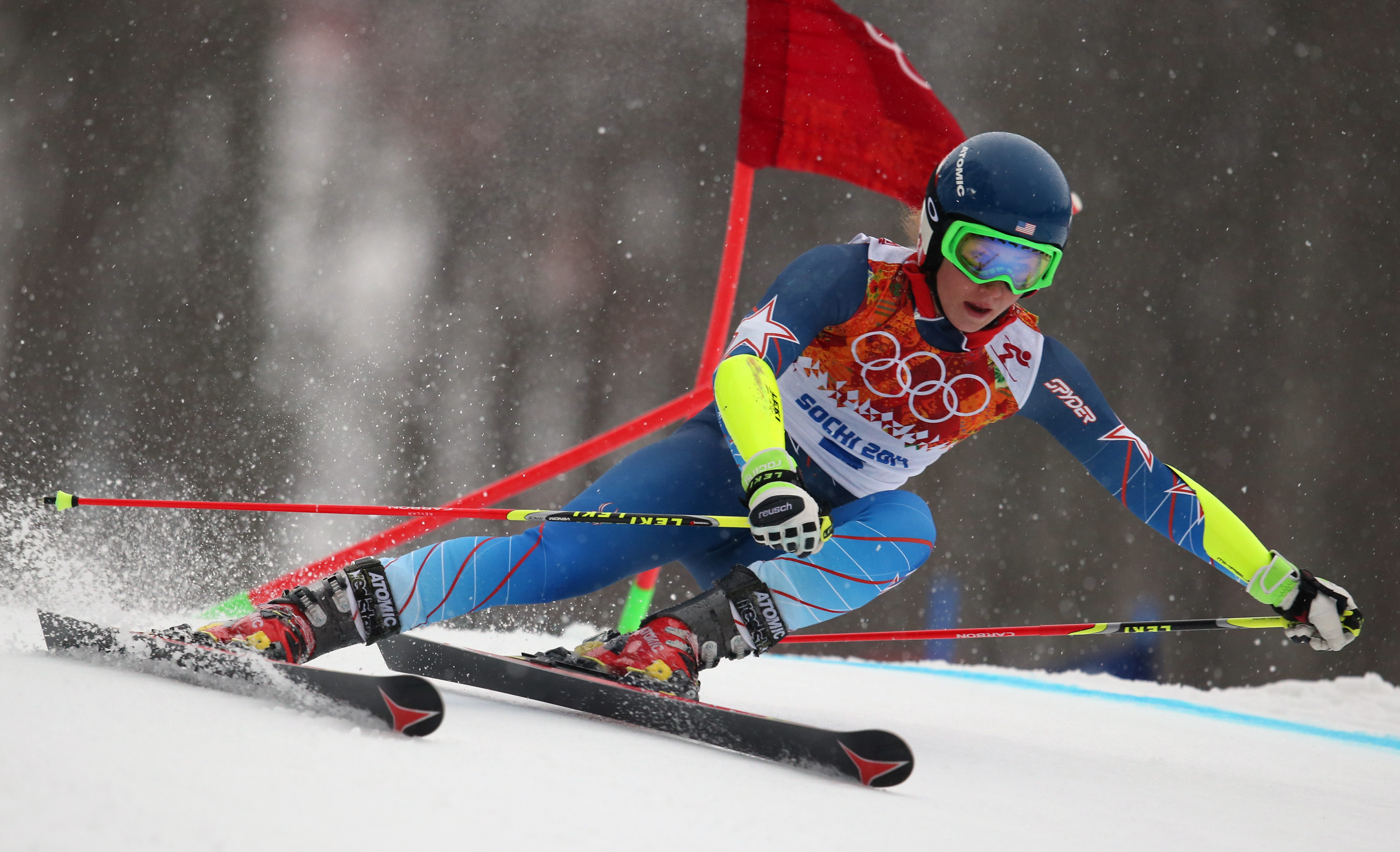 United States' Mikaela Shiffrin passes a gate in the first run of the women's giant slalom at the Sochi 2014 Winter Olympics, Tuesday, Feb. 18, 2014, in Krasnaya Polyana, Russia.(AP Photo/Alessandro Trovati)