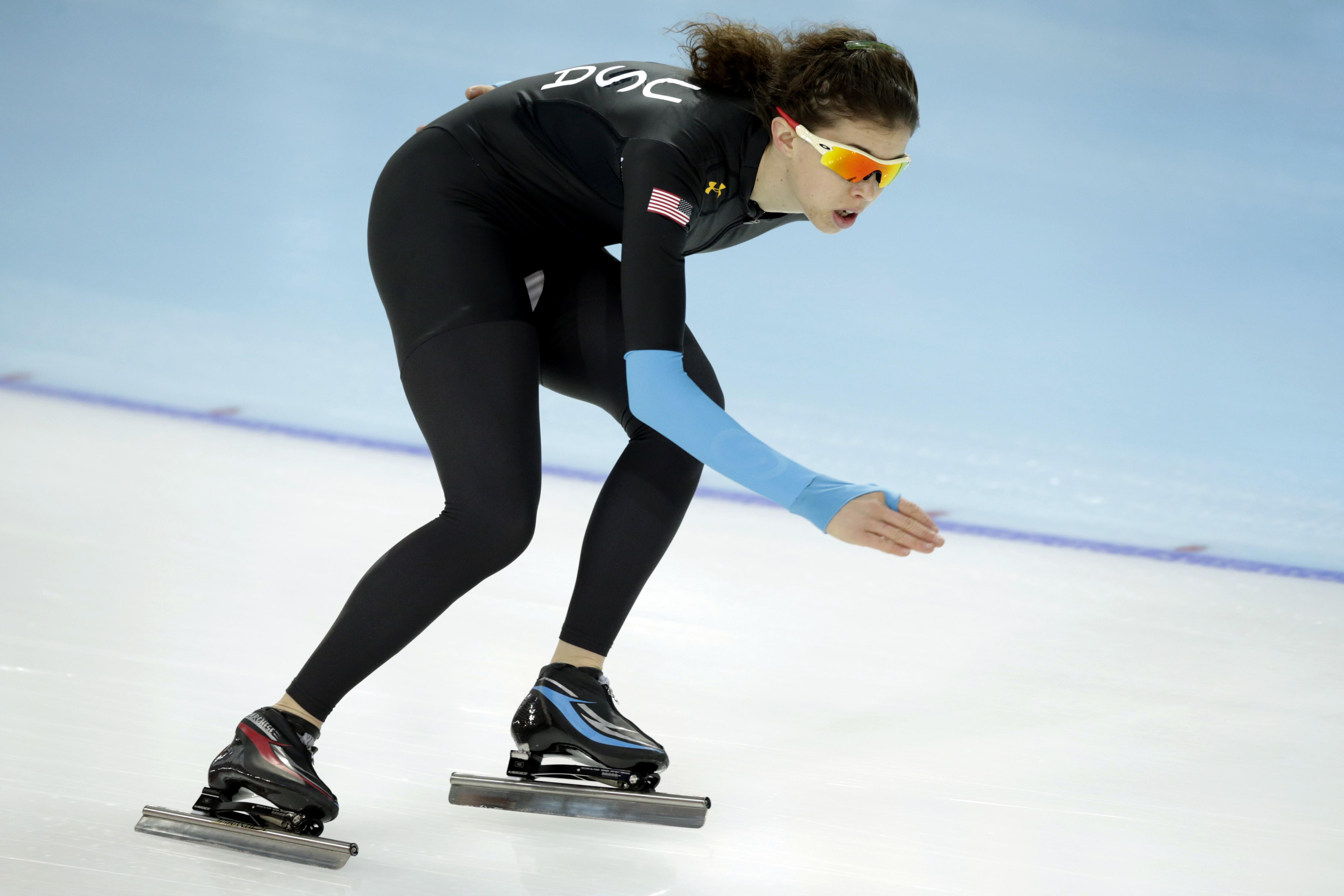 Speedskater Maria Lamb of the U.S. trains at the Adler Arena Skating Center during the 2014 Winter Olympics, Tuesday, Feb. 18, 2014, in Sochi, Russia. (AP Photo/Matt Dunham)
