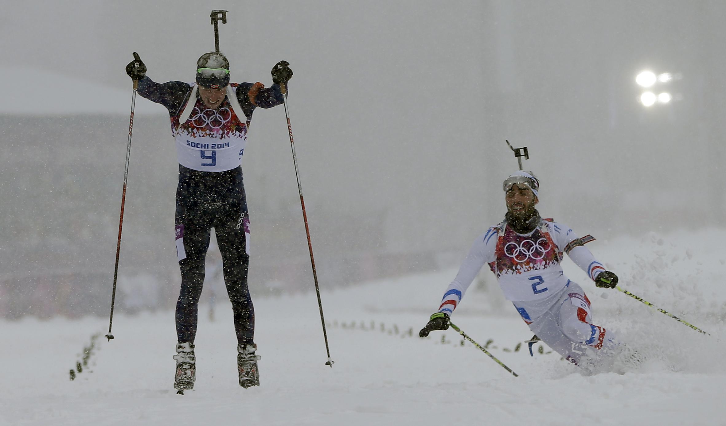 Norway's Emil Hegle Svendsen, left, outsprints France's Martin Fourcade to win the men's biathlon 15k mass-start, at the 2014 Winter Olympics, Tuesday, Feb. 18, 2014, in Krasnaya Polyana, Russia. (AP Photo/Felipe Dana)