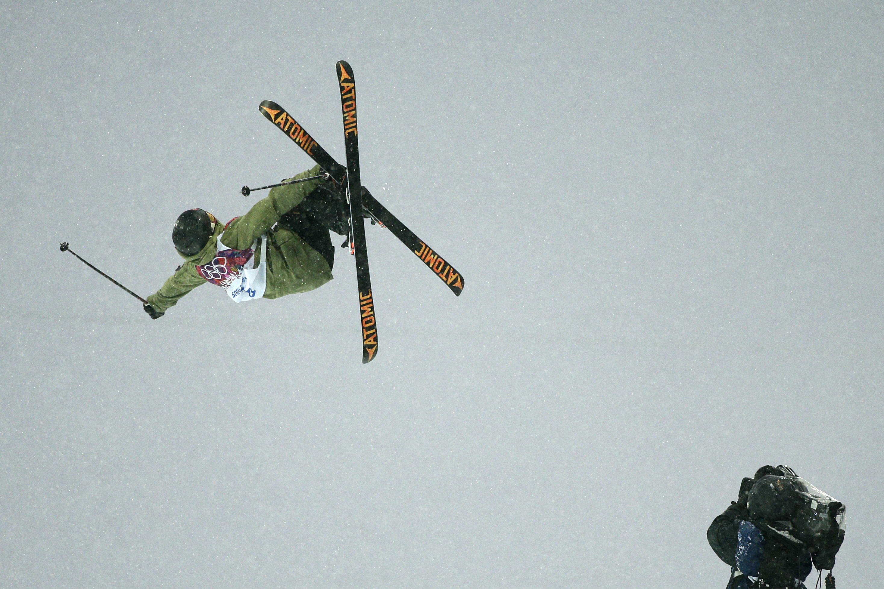 Switzerland's Yannic Lerjen catches air as he competes during the men's freestyle skiing halfpipe qualification at the Rosa Khutor Extreme Park, at the 2014 Winter Olympics, Tuesday, Feb. 18, 2014, in Krasnaya Polyana, Russia. (AP Photo/Jae C. Hong)