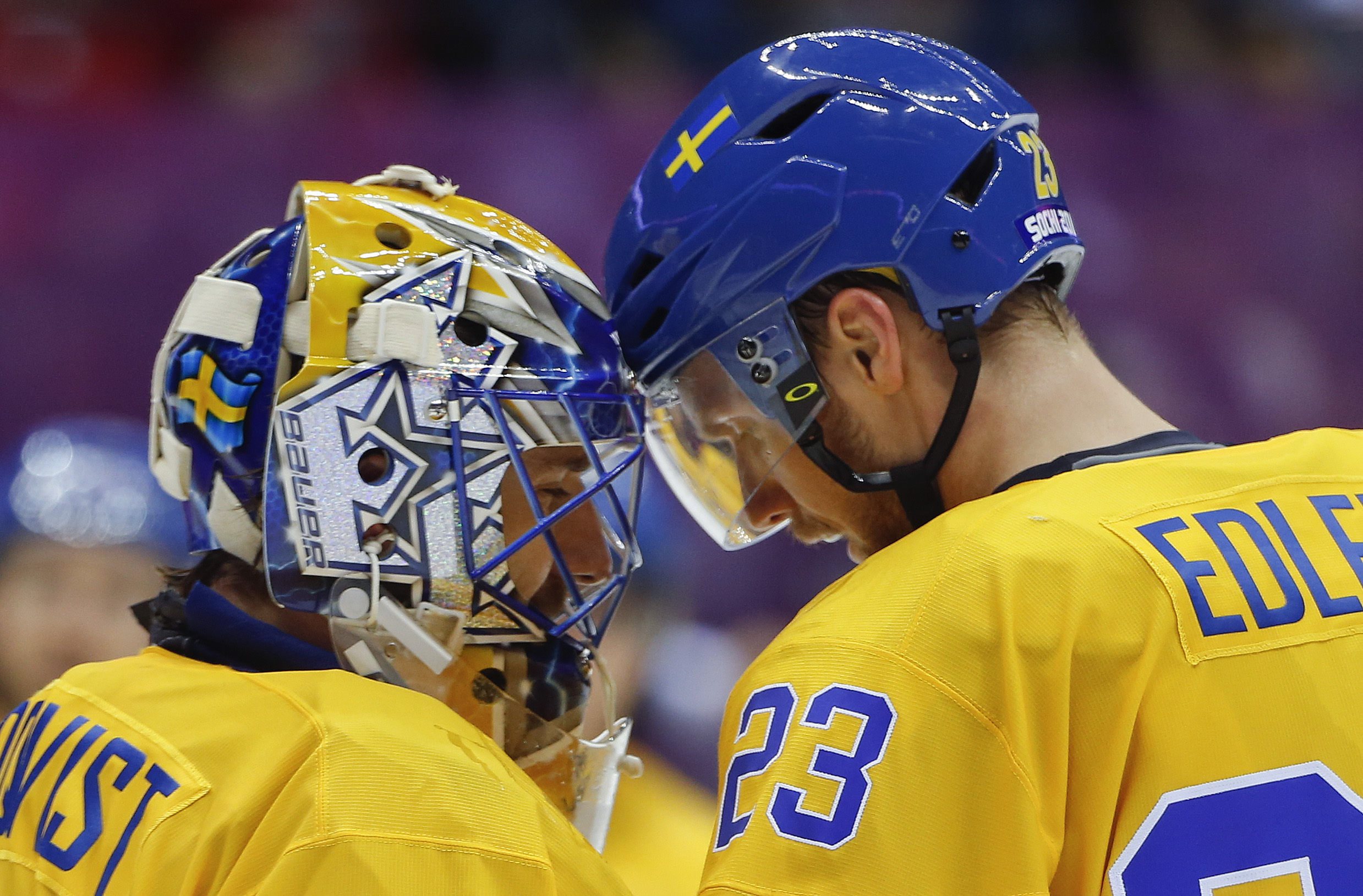 Sweden defenseman Alexander Edler congratulates goaltender Henrik Lundqvist on a shutout against Slovenia at the end of a men's quarterfinal ice hockey game at the 2014 Winter Olympics, Wednesday, Feb. 19, 2014, in Sochi, Russia. (AP Photo/Julio Cortez)