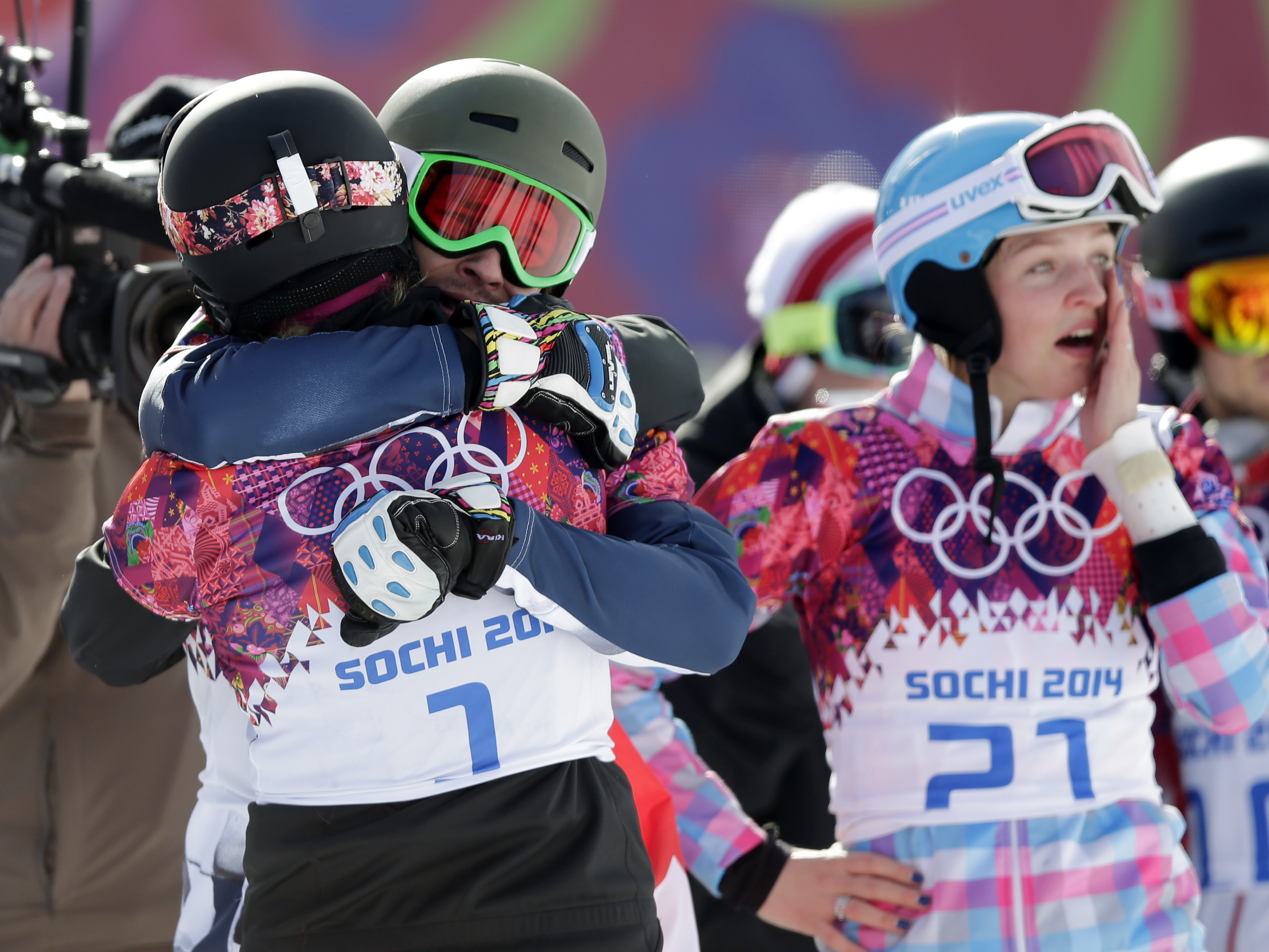 Men's snowboard parallel giant slalom gold medalist Russia's Vic Wild, center, celebrates with women's snowboard parallel giant slalom gold medalist Patrizia Kummer of Switzerland, left, as his wife and bronze medalist in the women's snowboard parallel giant slalom final, Russia's Alena Zavarzina also celebrates at right, at the Rosa Khutor Extreme Park, at the 2014 Winter Olympics, Wednesday, Feb. 19, 2014, in Krasnaya Polyana, Russia.  (AP Photo/Andy Wong)