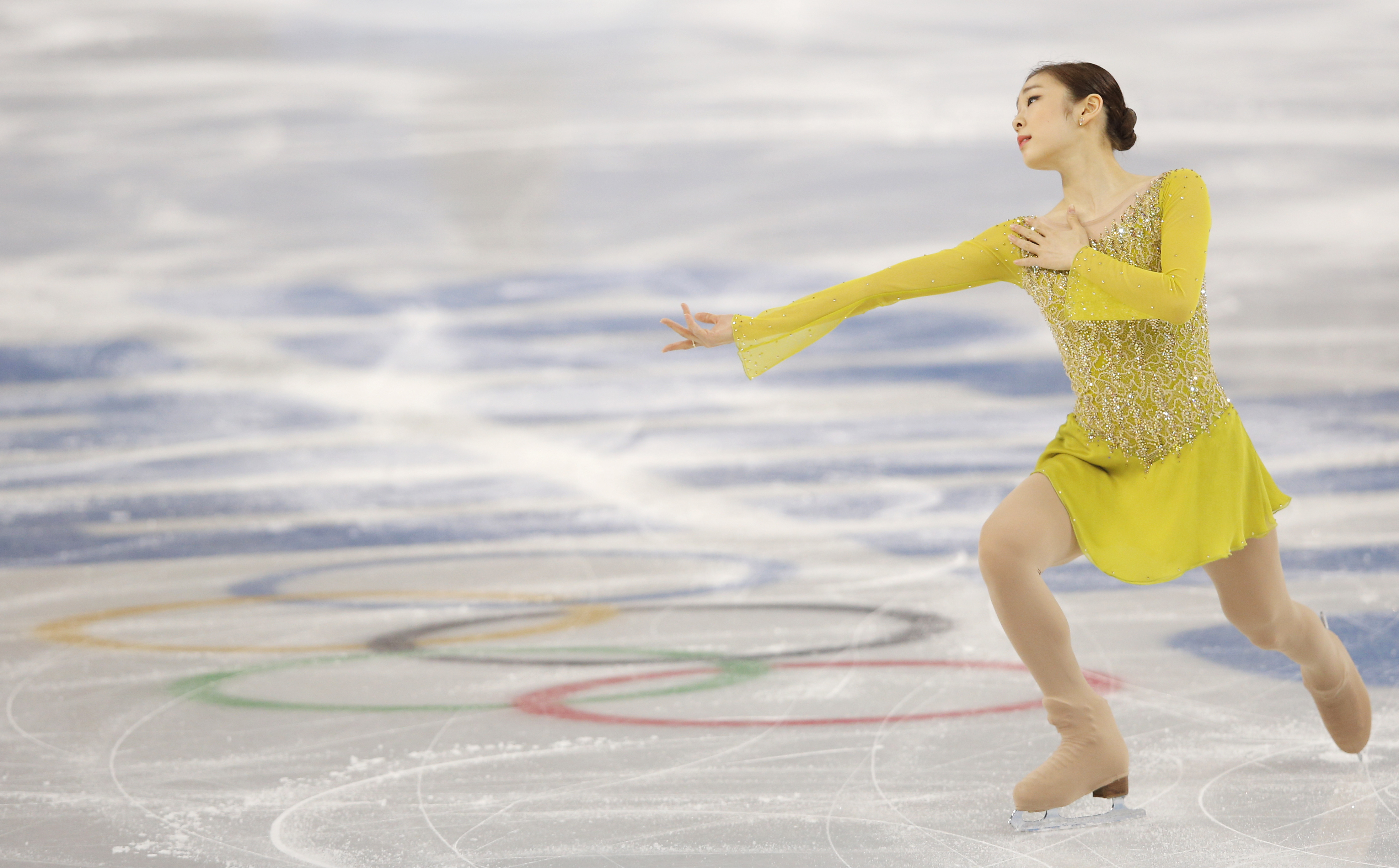 Yuna Kim of South Korea competes in the women's short program figure skating competition at the Iceberg Skating Palace during the 2014 Winter Olympics, Wednesday, Feb. 19, 2014, in Sochi, Russia. (AP Photo/Vadim Ghirda)