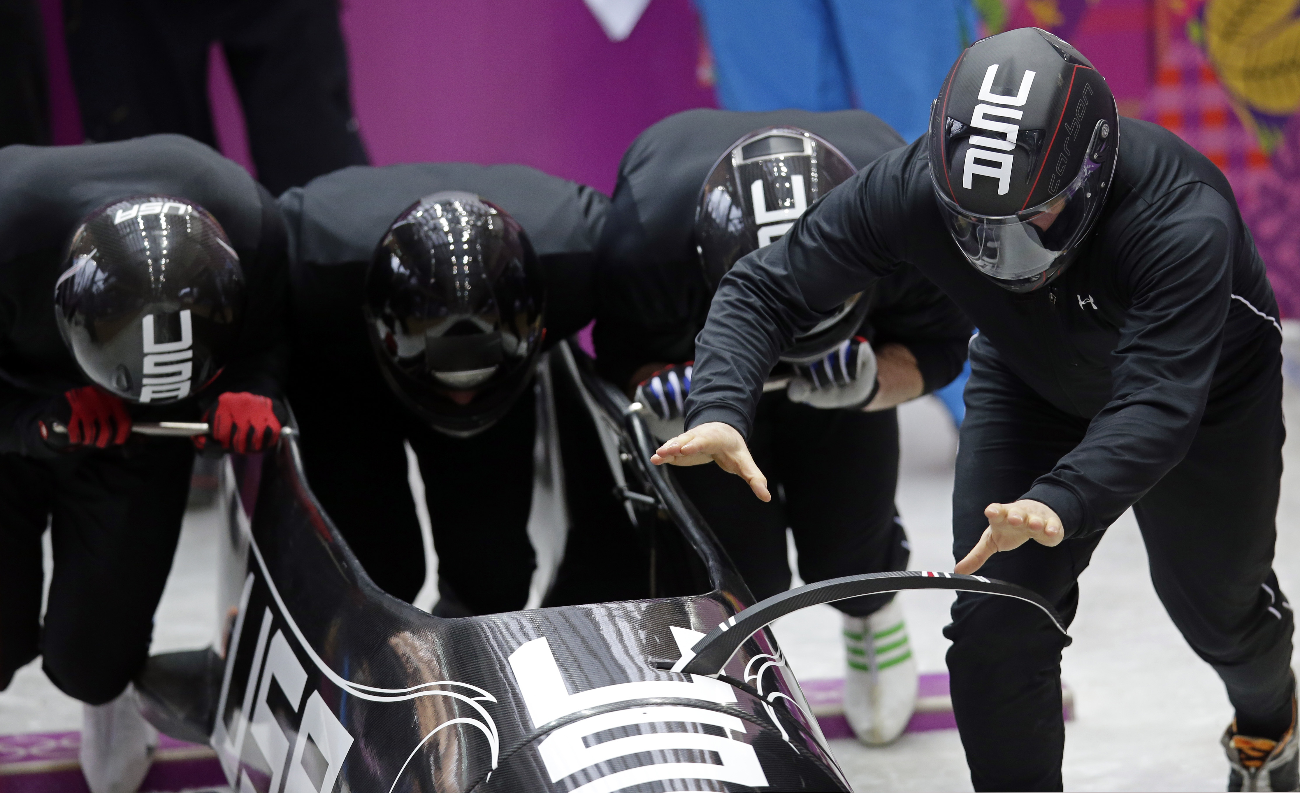 The team from the United States USA-1, piloted by Steven Holcomb, start a run during the men's four-man bobsled training at the 2014 Winter Olympics, Thursday, Feb. 20, 2014, in Krasnaya Polyana, Russia. (AP Photo/Michael Sohn)