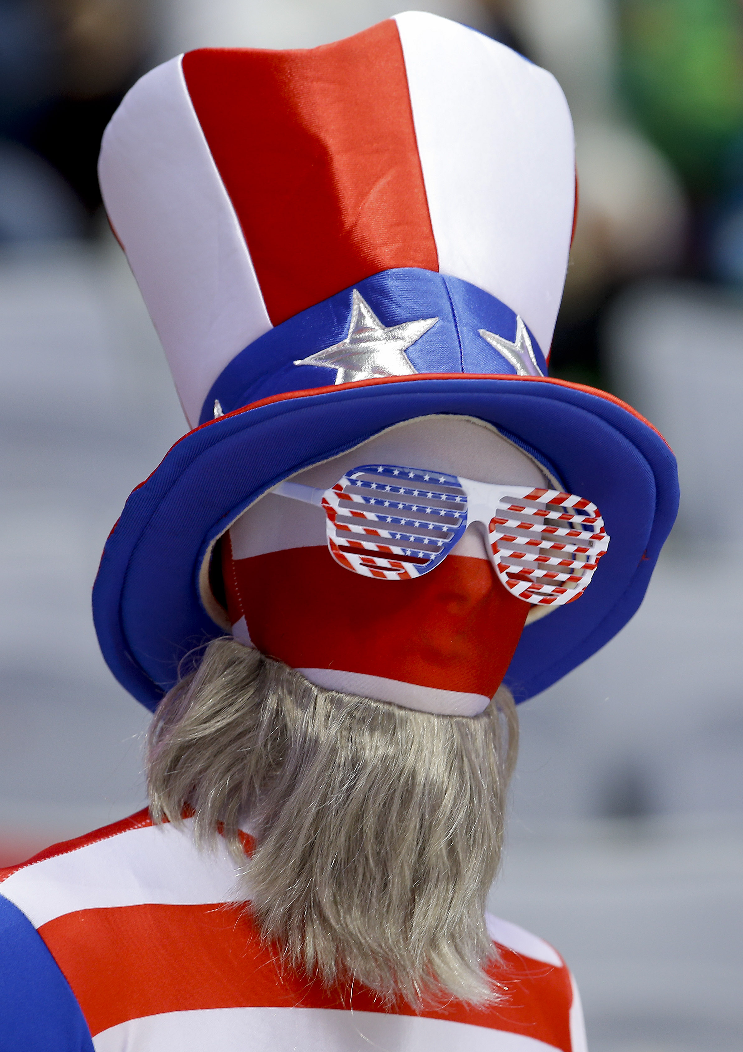 A USA hockey fan watches play against Canada during the women's gold medal ice hockey game at the 2014 Winter Olympics, Thursday, Feb. 20, 2014, in Sochi, Russia. (AP Photo/Matt Slocum)
