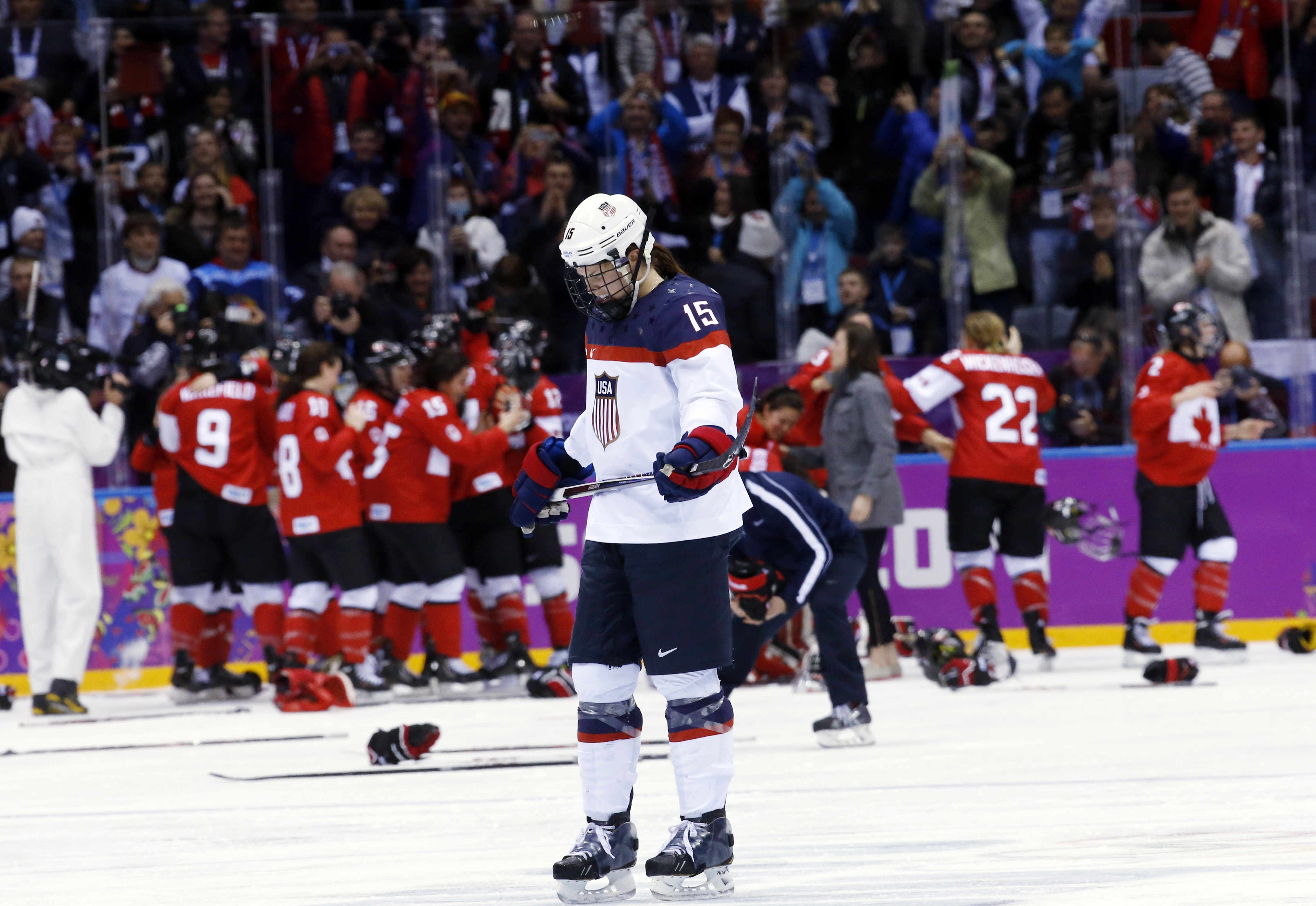 Anne Schleper of the United States (15) skates back to the bench after Canada scored in overtime to win the women's gold medal ice hockey game 3-2 at the 2014 Winter Olympics, Thursday, Feb. 20, 2014, in Sochi, Russia. (AP Photo/Matt Slocum)