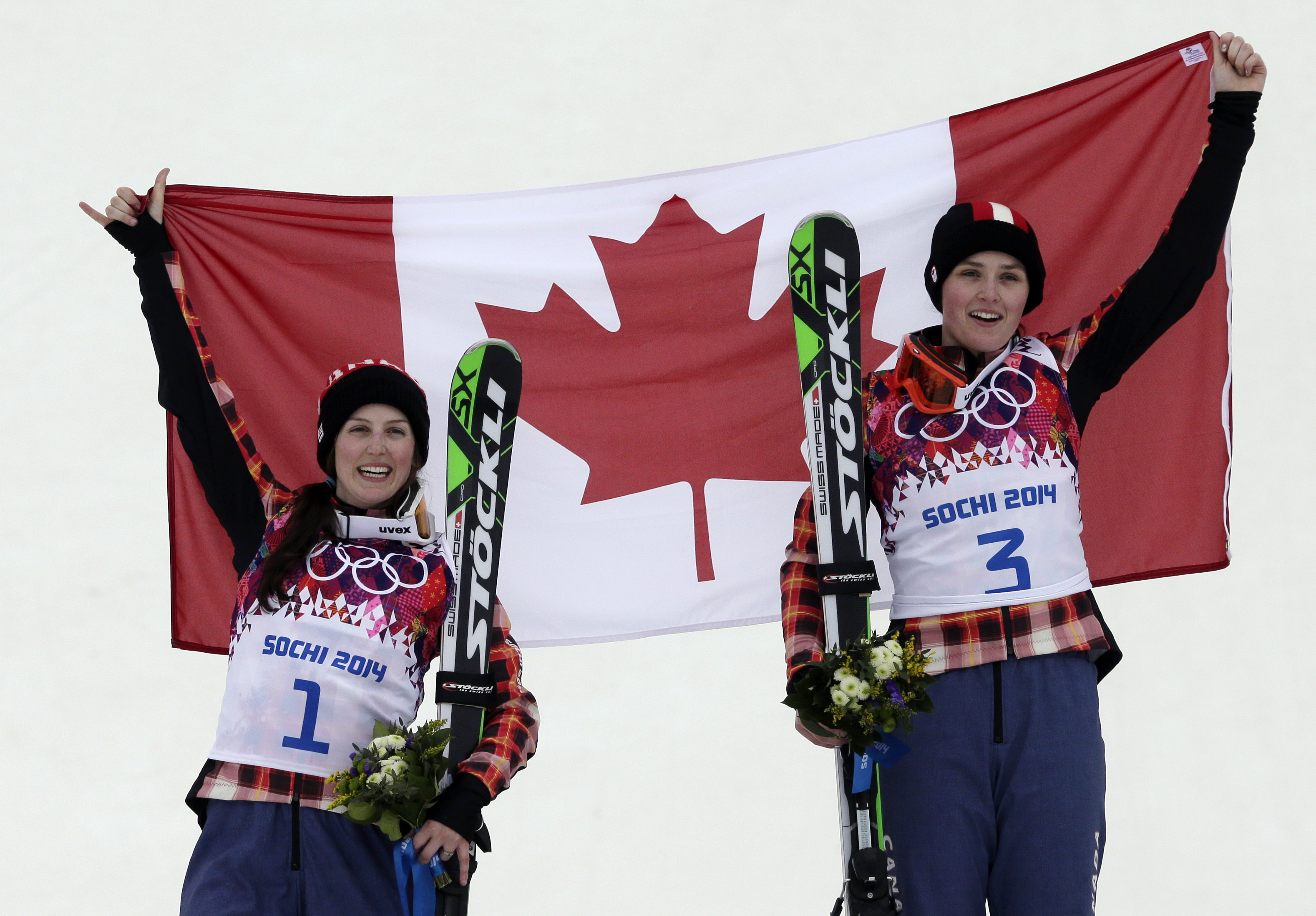 Women's ski cross gold medalist Marielle Thompson of Canada, right, celebrates on the podium with silver medalist and compatriot Kelsey Serwa, left, at the Rosa Khutor Extreme Park, at the 2014 Winter Olympics, Friday, Feb. 21, 2014, in Krasnaya Polyana, Russia. (AP Photo/Andy Wong)