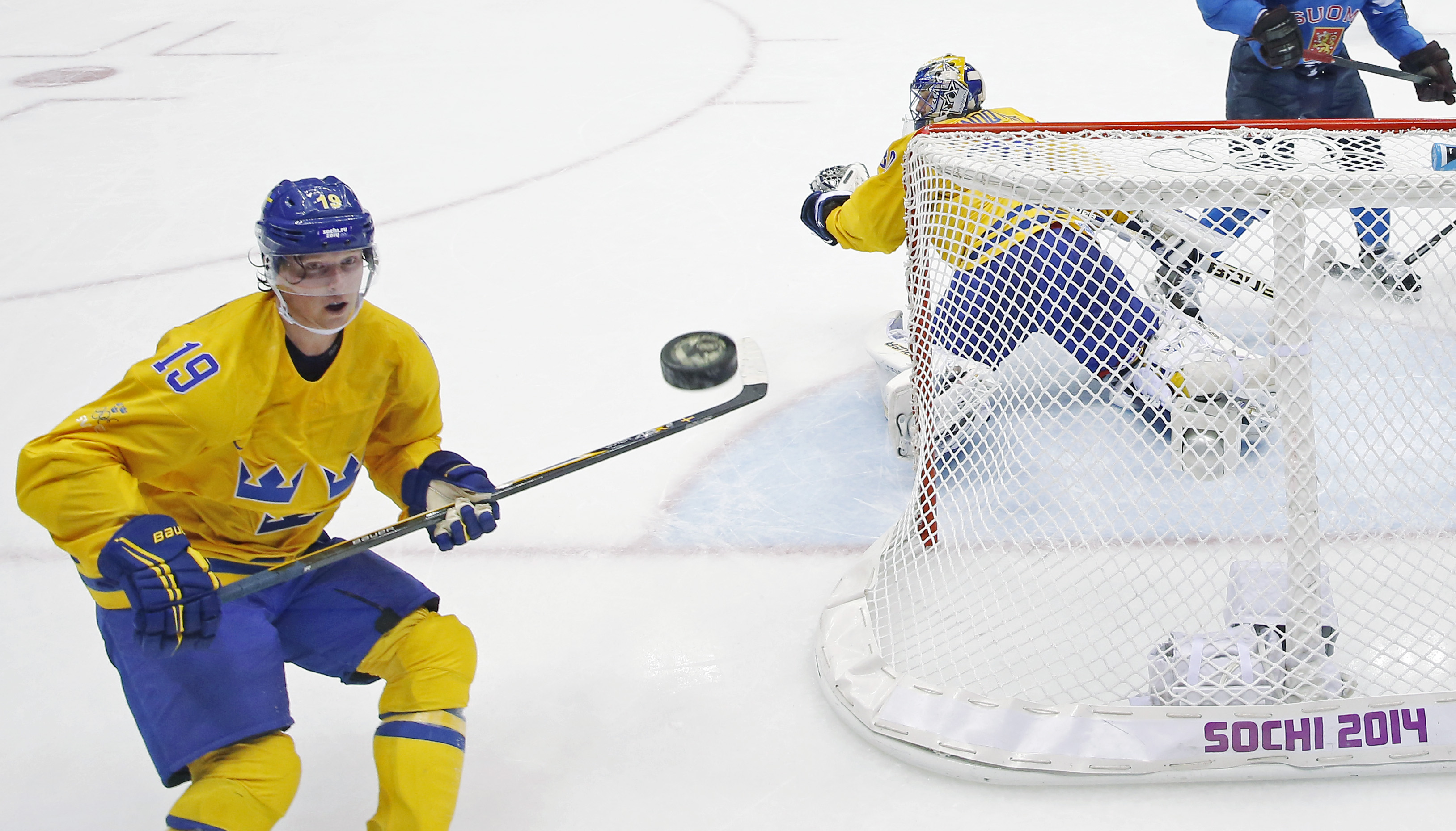 Sweden forward Nicklas Backstrom watches a shot that got past Sweden goaltender Henrik Lundqvist during a men's semifinal ice hockey game against Finland at the 2014 Winter Olympics, Friday, Feb. 21, 2014, in Sochi, Russia. (AP Photo/David J. Phillip)