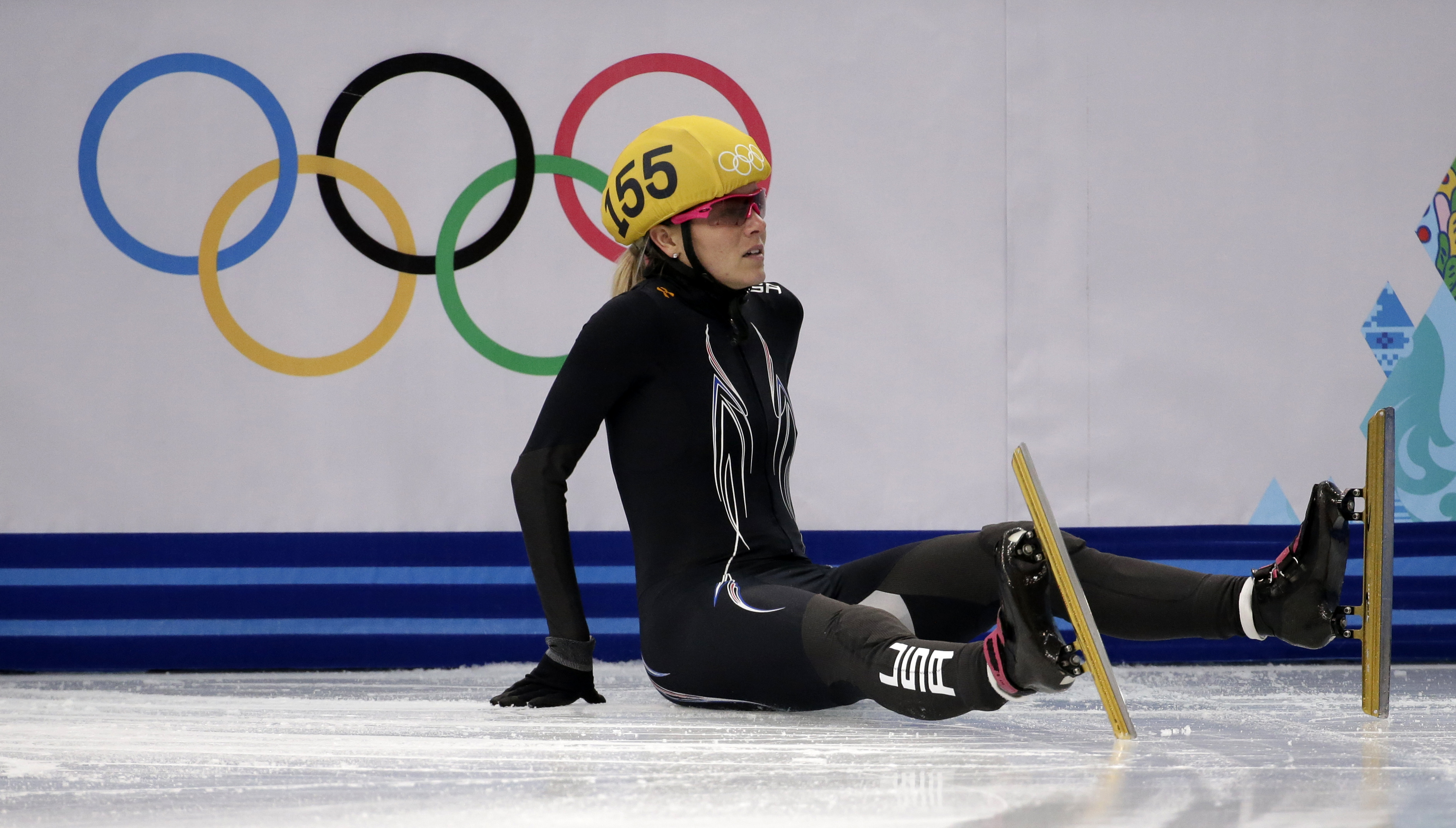 Emily Scott of the United States crashes out in a women's 1000m short track speedskating quarterfinal at the Iceberg Skating Palace during the 2014 Winter Olympics, Friday, Feb. 21, 2014, in Sochi, Russia. (AP Photo/Bernat Armangue)