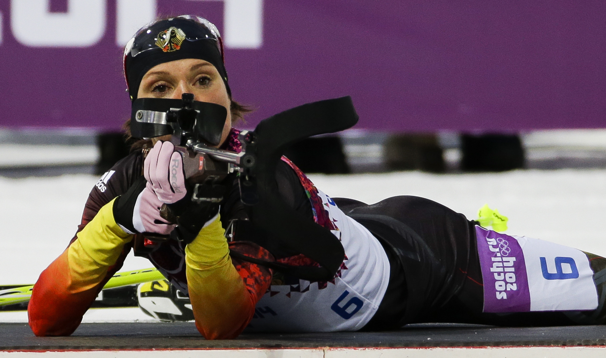 """FILE - In this Feb. 9, 2014 file photo, Germany's Evi Sachenbacher-Stehle prepares to shoot during the women's biathlon 7.5k sprint, at the 2014 Winter Olympics, in Krasnaya Polyana, Russia. German Olympic officials said Sachenbacher-Stehle has been kicked out of the Sochi Games after a positive doping test. The German Olympic Committee said she tested positive on Monday, Feb. Feb. 17, for the stimulant methylhexanamine. Both the """"A'' sample and backup """"B'' sample were positive. The committee said the athlete has been removed from the team and is being sent home.  (AP Photo/Gero Breloer, File)"""