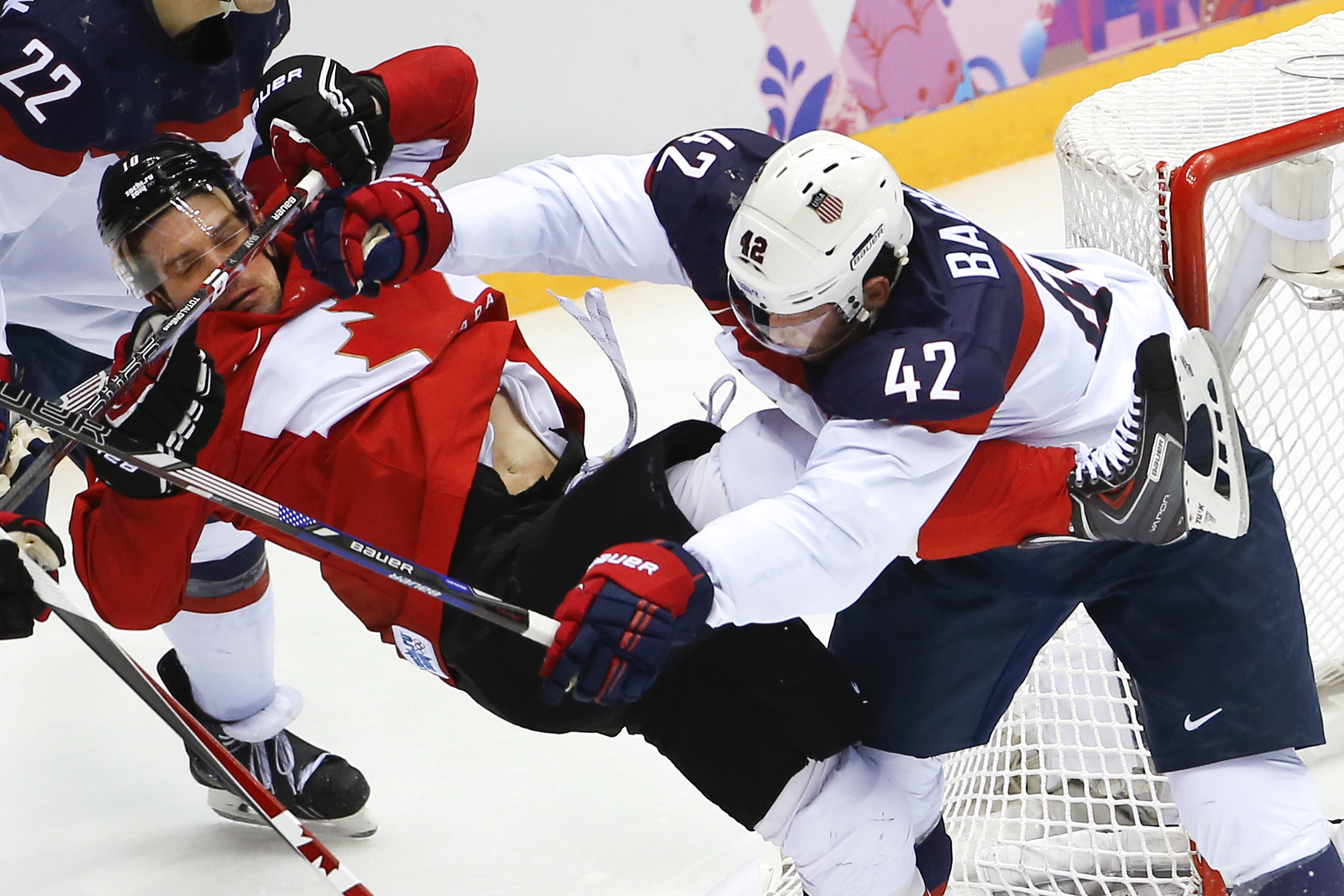USA forward David Backes mixes it up with Canada forward Patrick Sharp during the second period of the men's semifinal ice hockey game at the 2014 Winter Olympics, Friday, Feb. 21, 2014, in Sochi, Russia. (AP Photo/Matt Slocum)