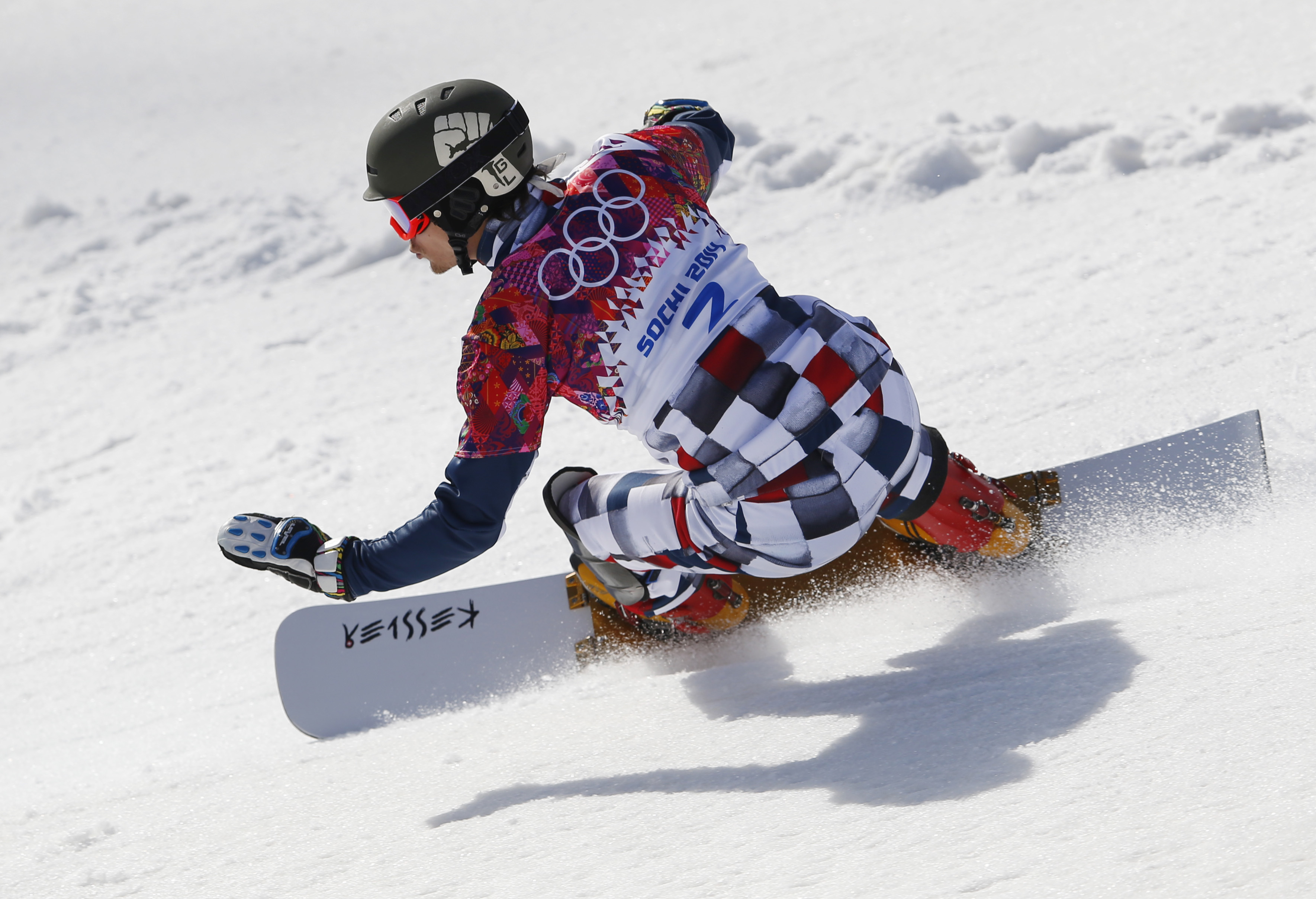 Russia's Vic Wild competes during snowboard parallel slalom qualifying at the Rosa Khutor Extreme Park, at the 2014 Winter Olympics, Saturday, Feb. 22, 2014, in Krasnaya Polyana, Russia. (AP Photo/Sergei Grits)
