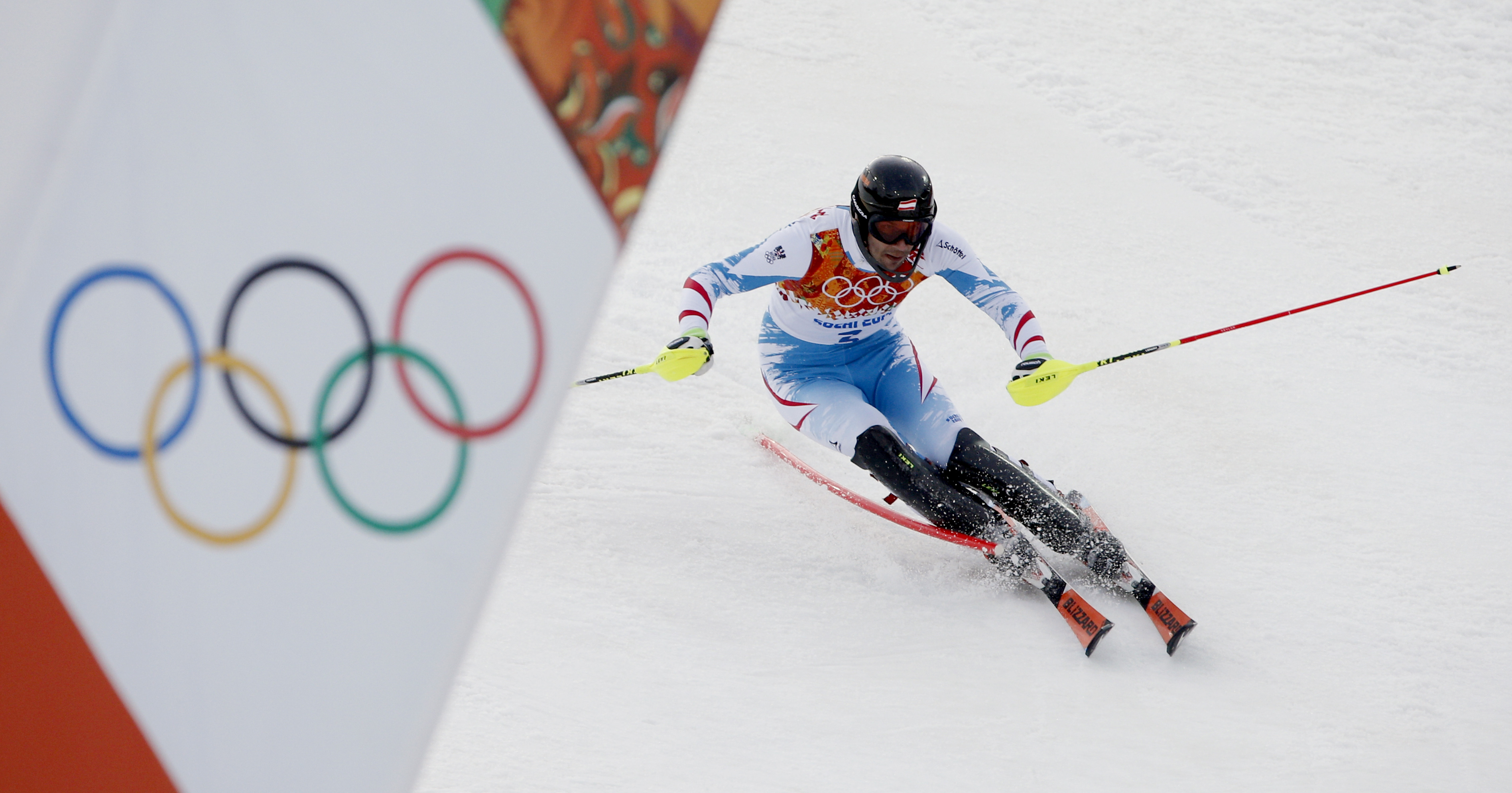 Austria's Mario Matt nears the finish in the men's slalom at the Sochi 2014 Winter Olympics, Saturday, Feb. 22, 2014, in Krasnaya Polyana, Russia. (AP Photo/Christophe Ena)