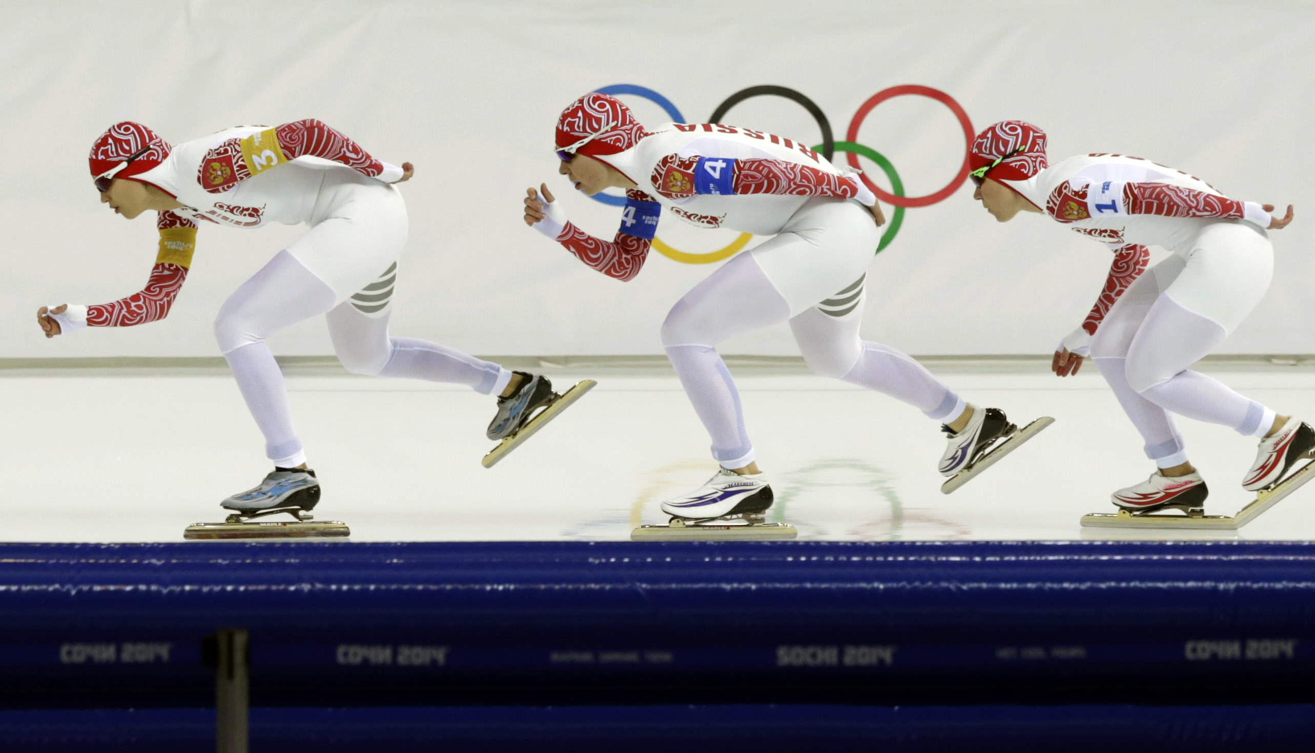 Speedskaters from Russia, left to right, Yekaterina Shikhova, Yulia Skokova, and Olga Graf compete in the women's speedskating team pursuit semifinals at the Adler Arena Skating Center at the 2014 Winter Olympics, Saturday, Feb. 22, 2014, in Sochi, Russia. (AP Photo/Matt Dunham)