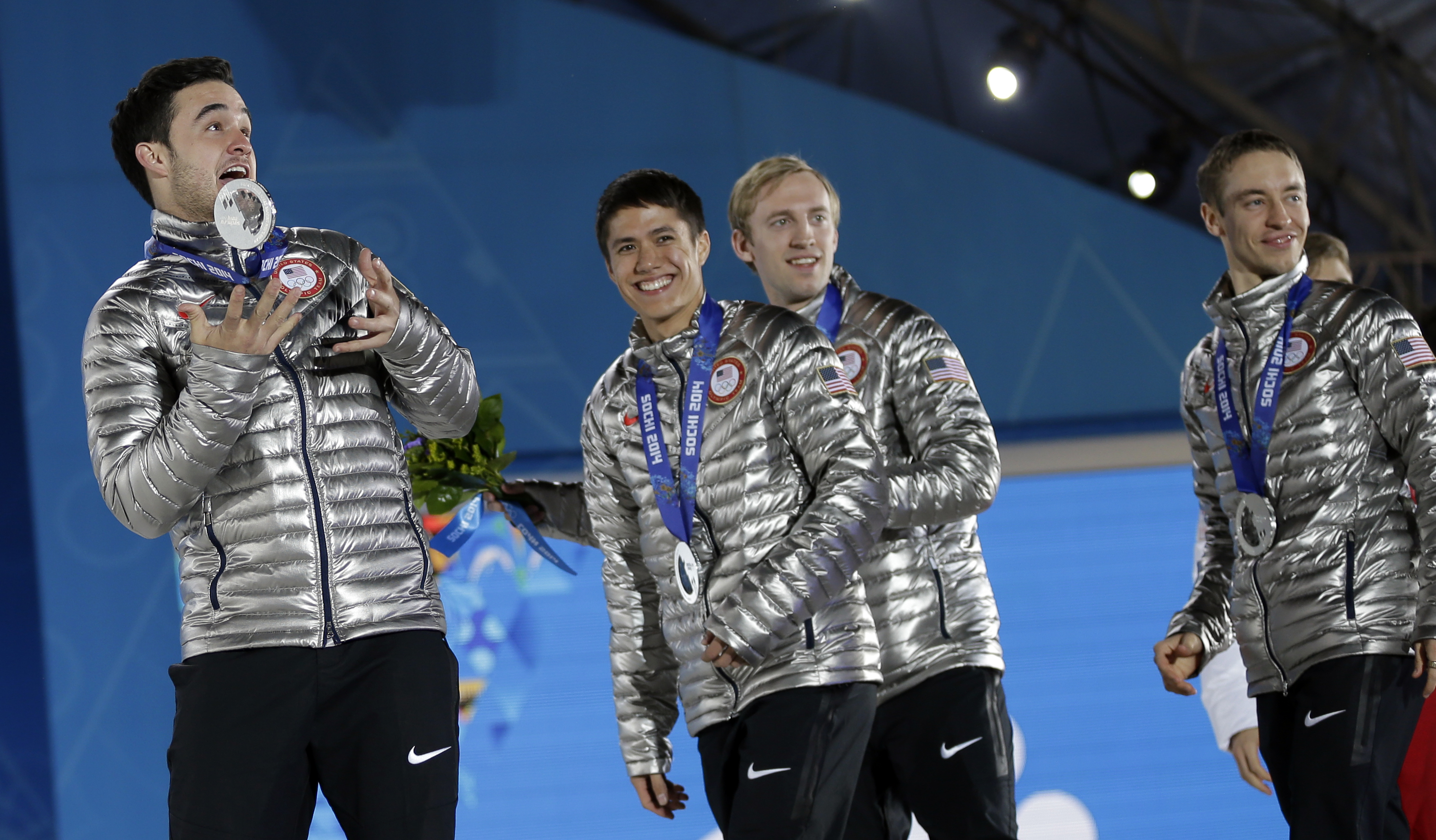 The team from the United States, who won the silver medal in the men's short track speedskating 5,000-meter relay, smile while exiting the stage following their medals ceremony at the 2014 Winter Olympics, Saturday, Feb. 22, 2014, in Sochi, Russia. (AP Photo/David Goldman)