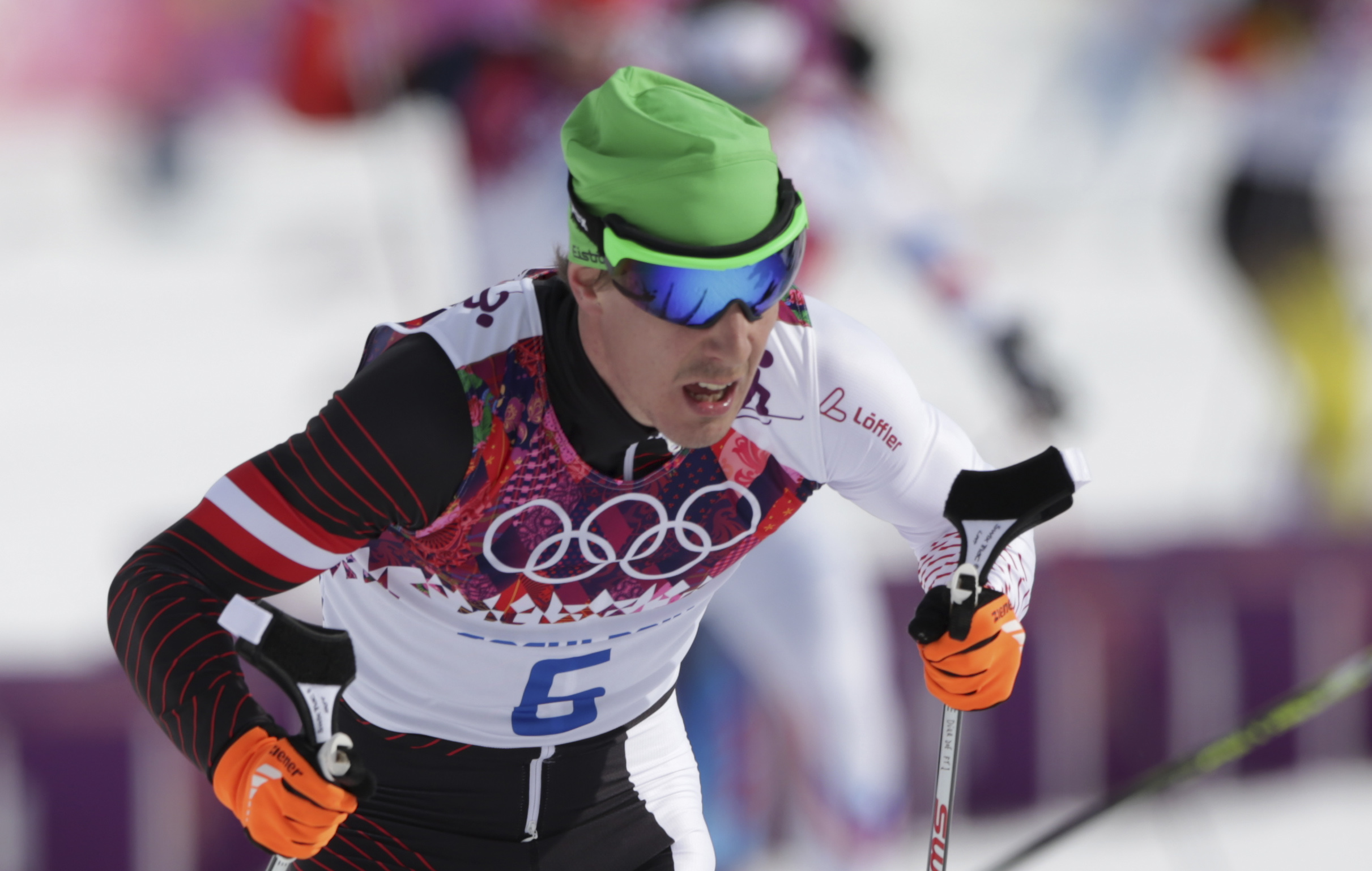 In this Feb. 9, 2014 photo Austria's Johannes Duerr competes during the men's cross-country 30k skiathlon at the 2014 Winter Olympics in Krasnaya Polyana, Russia. Duerr has been kicked out of the Sochi Games after testing positive for EPO, the country's Olympic committee said Sunday, Feb 23, 2014. It is the fifth doping case of the Olympics and the first involving the blood-boosting drug EPO. (AP Photo/Matthias Schrader)