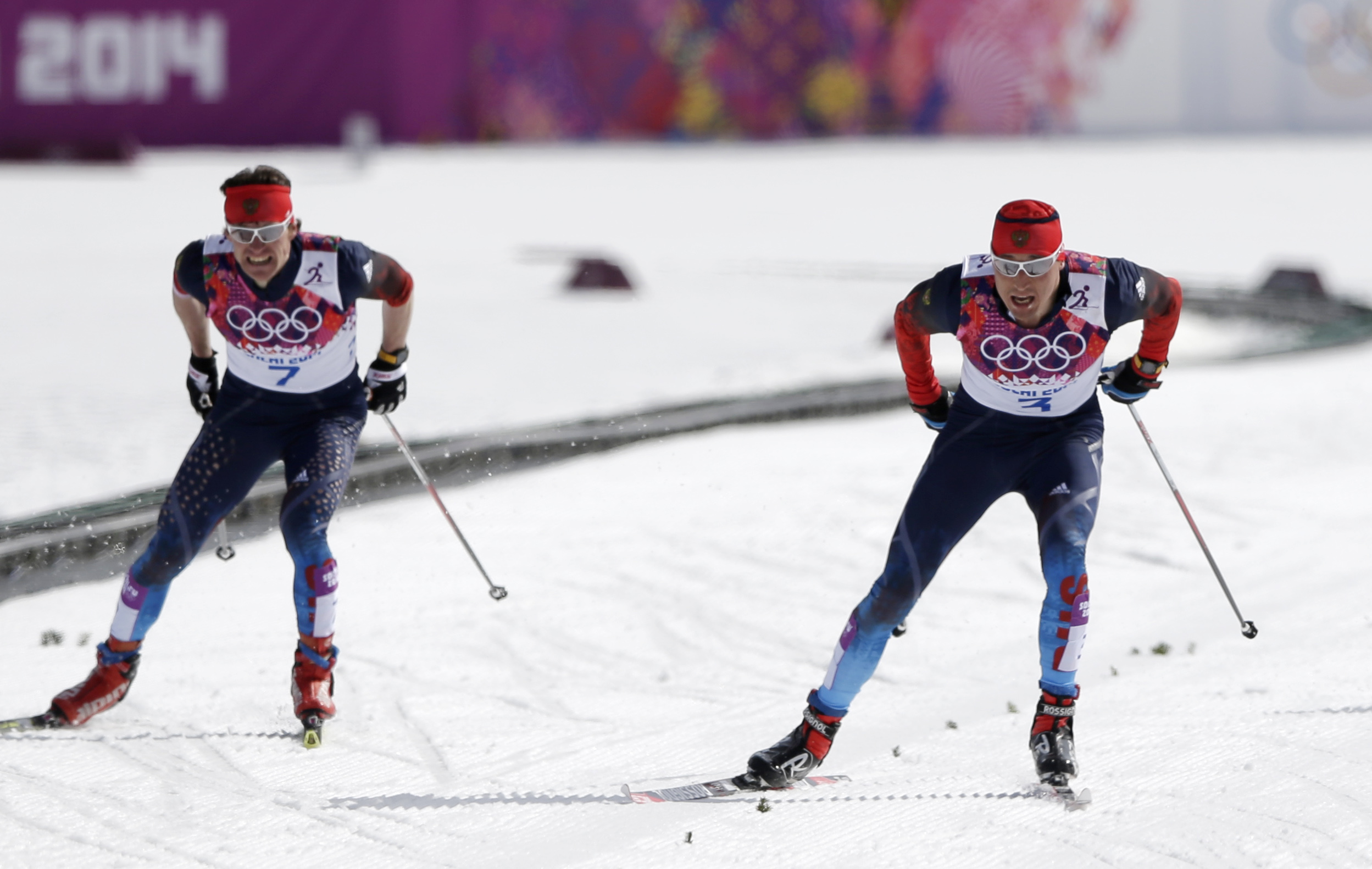 Russia's Alexander Legkov skis to win the gold during the men's 50K cross-country race at the 2014 Winter Olympics, Sunday, Feb. 23, 2014, in Krasnaya Polyana, Russia. (AP Photo/Matthias Schrader)