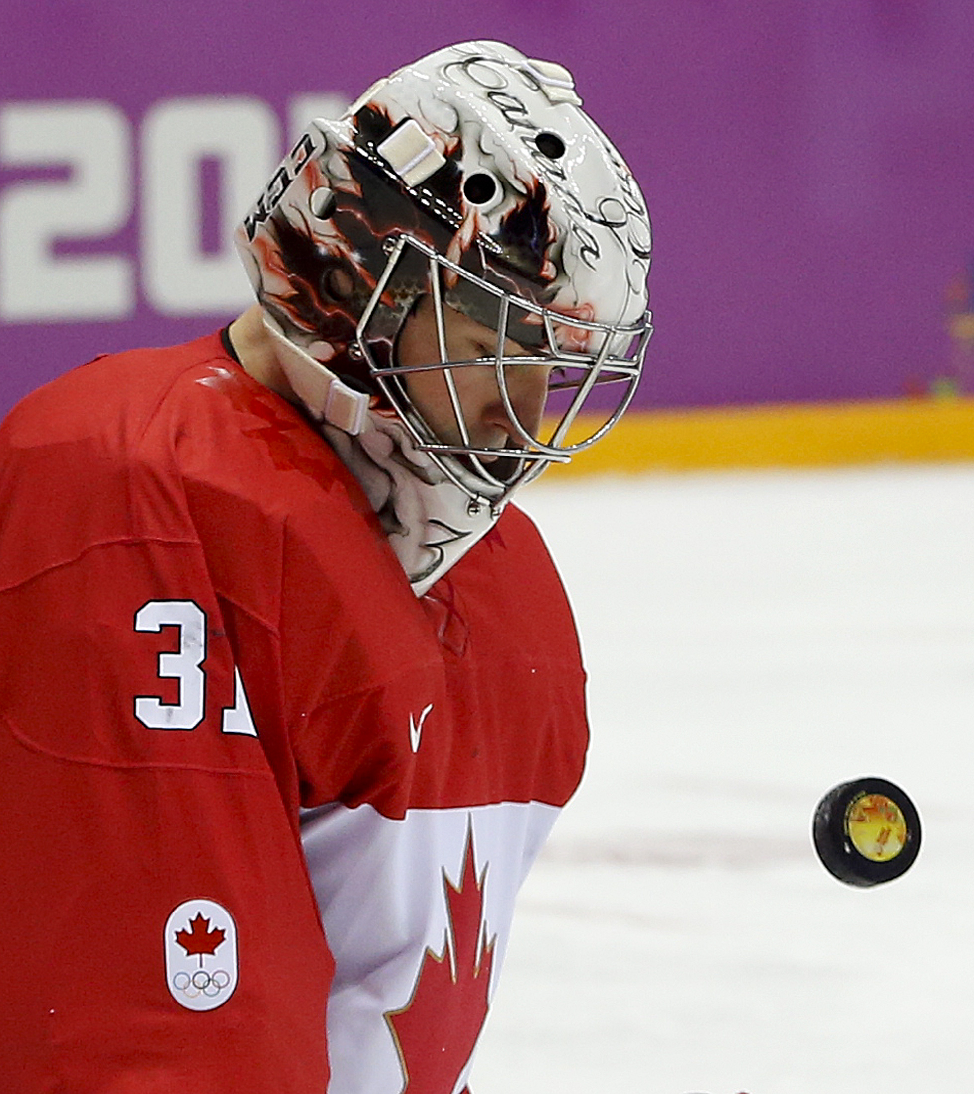 Canada goaltender Carey Price blocks a shot by Sweden during the first period of the men's gold medal ice hockey game at the 2014 Winter Olympics, Sunday, Feb. 23, 2014, in Sochi, Russia. (AP Photo/Julio Cortez)